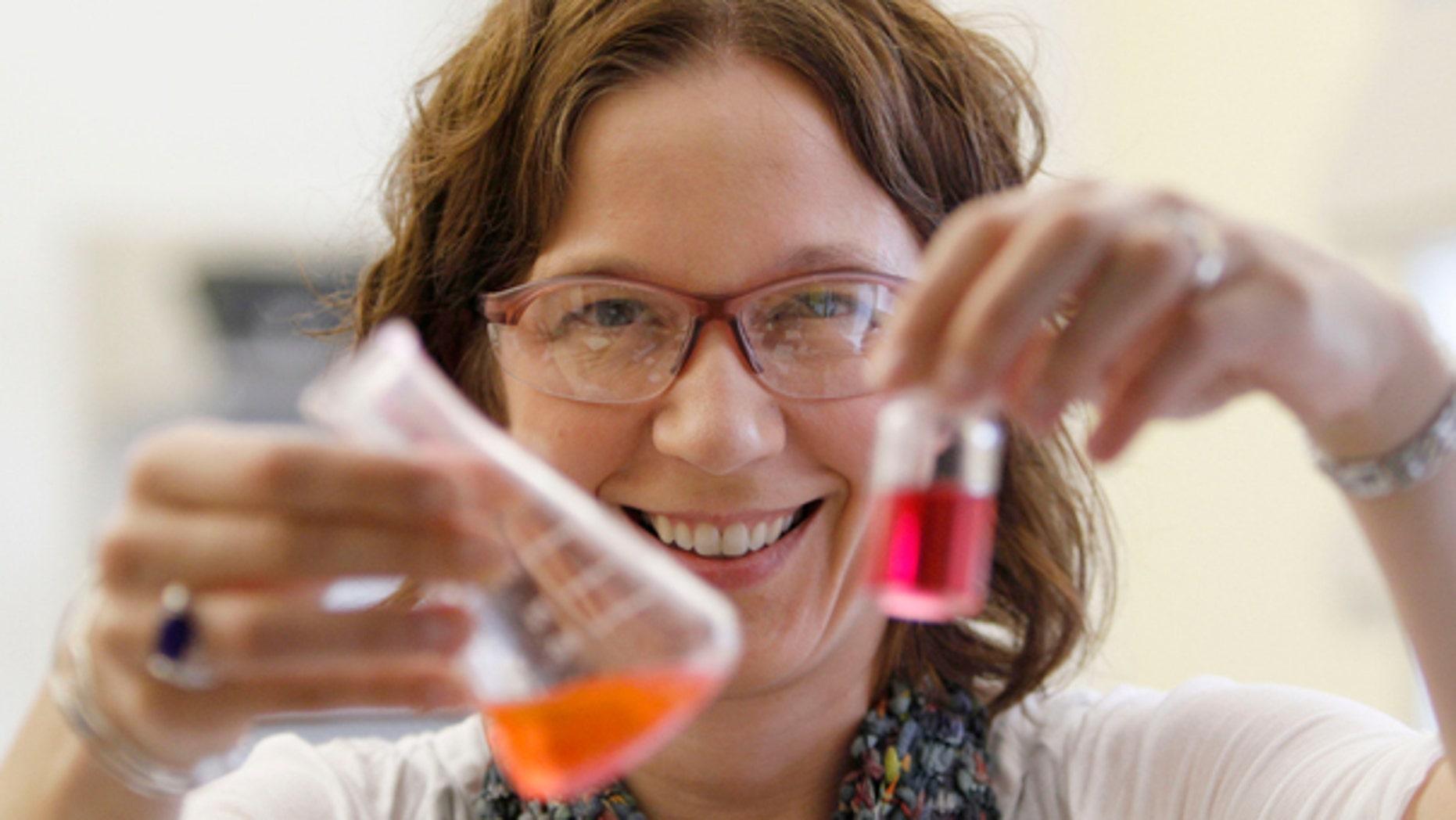 Sept. 15, 2011: William & Mary professor Elizabeth Harbron displays vials with merocyanine and rhodamine dye in her lab in Williamsburg, Va.