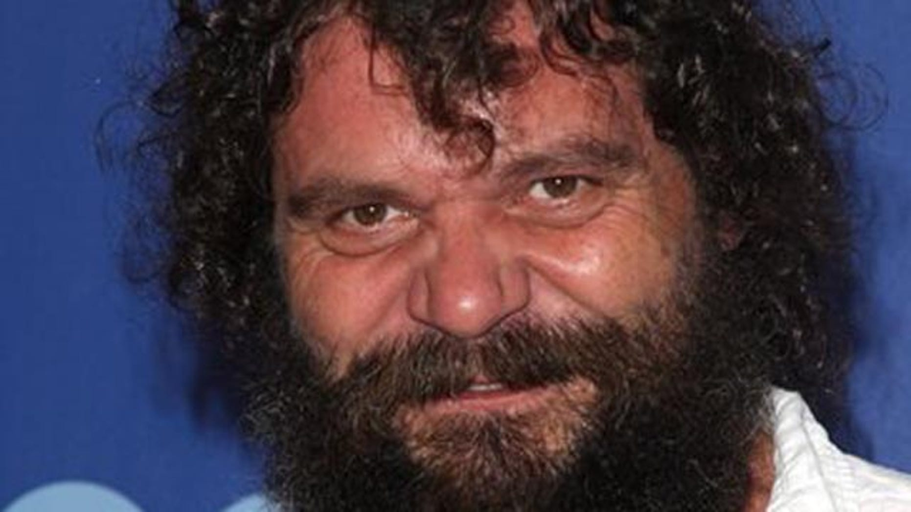 """FILE - In this May 19, 2010 file photo, former """"Survivor"""" contestant Rupert Boneham poses for a photo as he attends the CBS Upfront presentation in New York."""