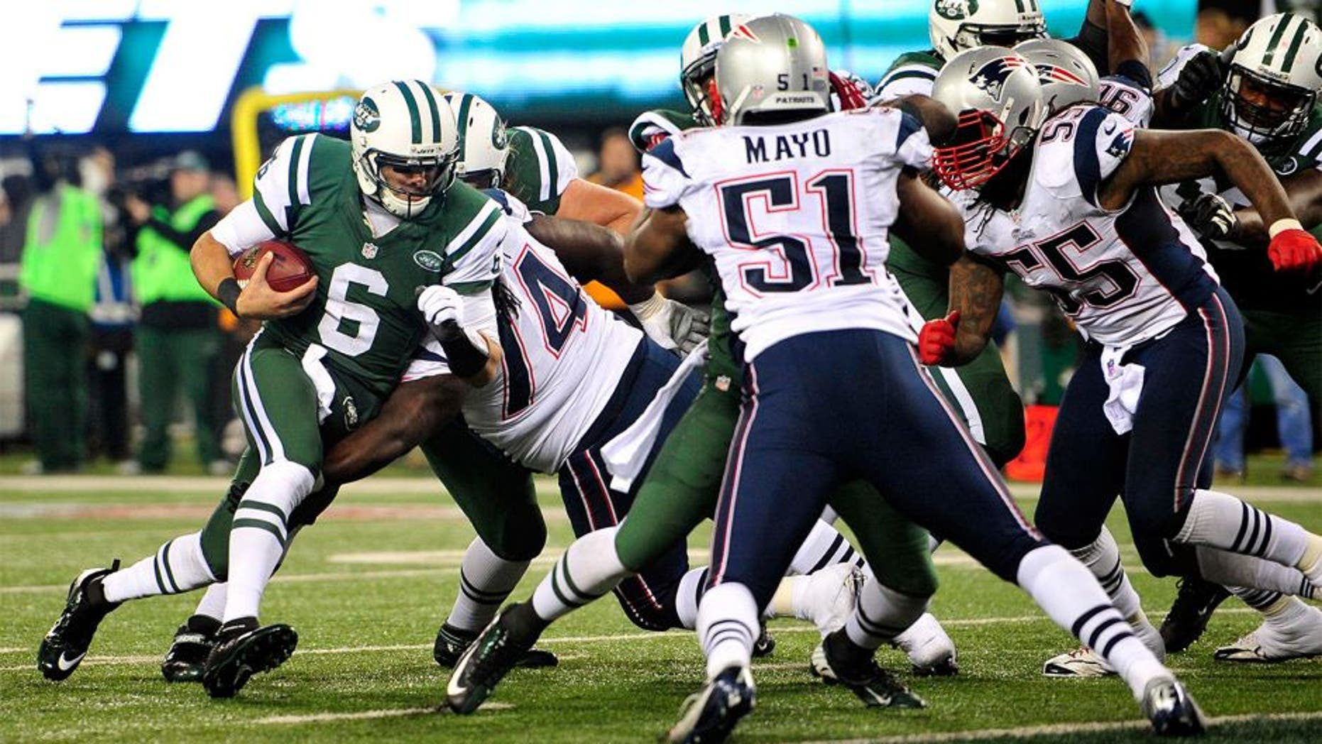 Nov 22, 2012; East Rutherford, NJ, USA; New York Jets quarterback Mark Sanchez (6) runs against the New England Patriots during the second half on Thanksgiving at Metlife Stadium. Mandatory Credit: Joe Camporeale-USA TODAY Sports