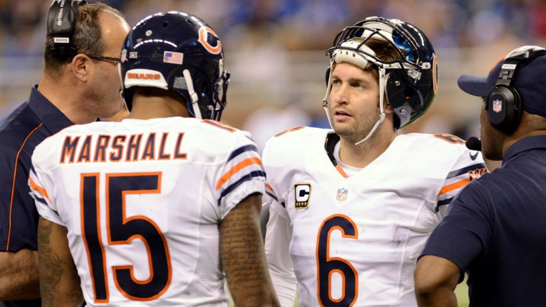 DETROIT, MI - DECEMBER 30: Brandon Marshall #15 and Jay Cutler #6 of the Chicago Bears talk with coaches on the sidelines during the game against the Detroit Lions at Ford Field on December 30, 2012 in Detroit, Michigan. The Bears defeated the Lions 26-24. (Photo by Mark Cunningham/Detroit Lions/Getty Images)
