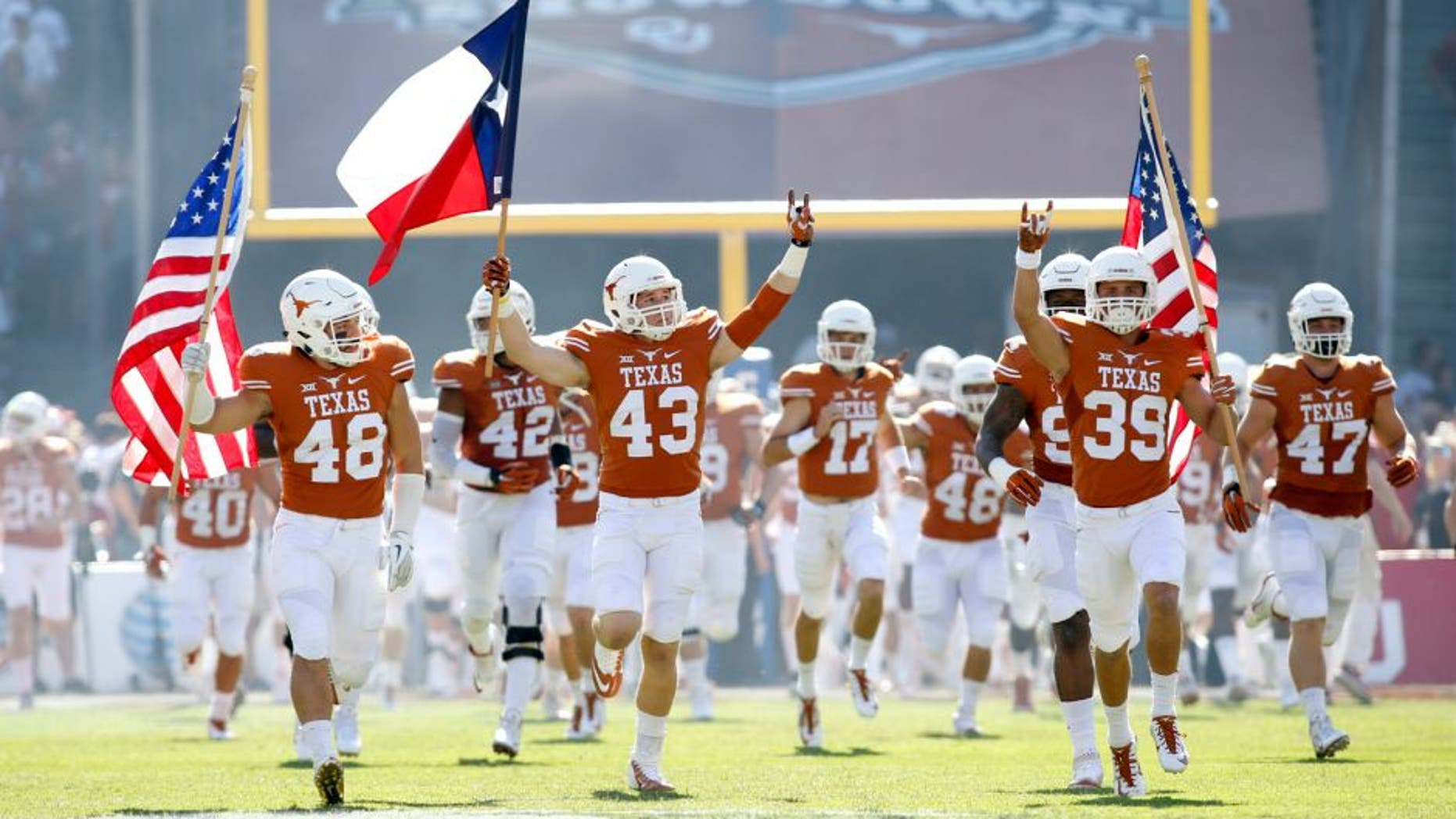 Oct 10, 2015; Dallas, TX, USA; Texas Longhorns players takes the field before the game against the Oklahoma Sooners at the Red River rivalry at Cotton Bowl Stadium. Texas won 24-17. Mandatory Credit: Tim Heitman-USA TODAY Sports