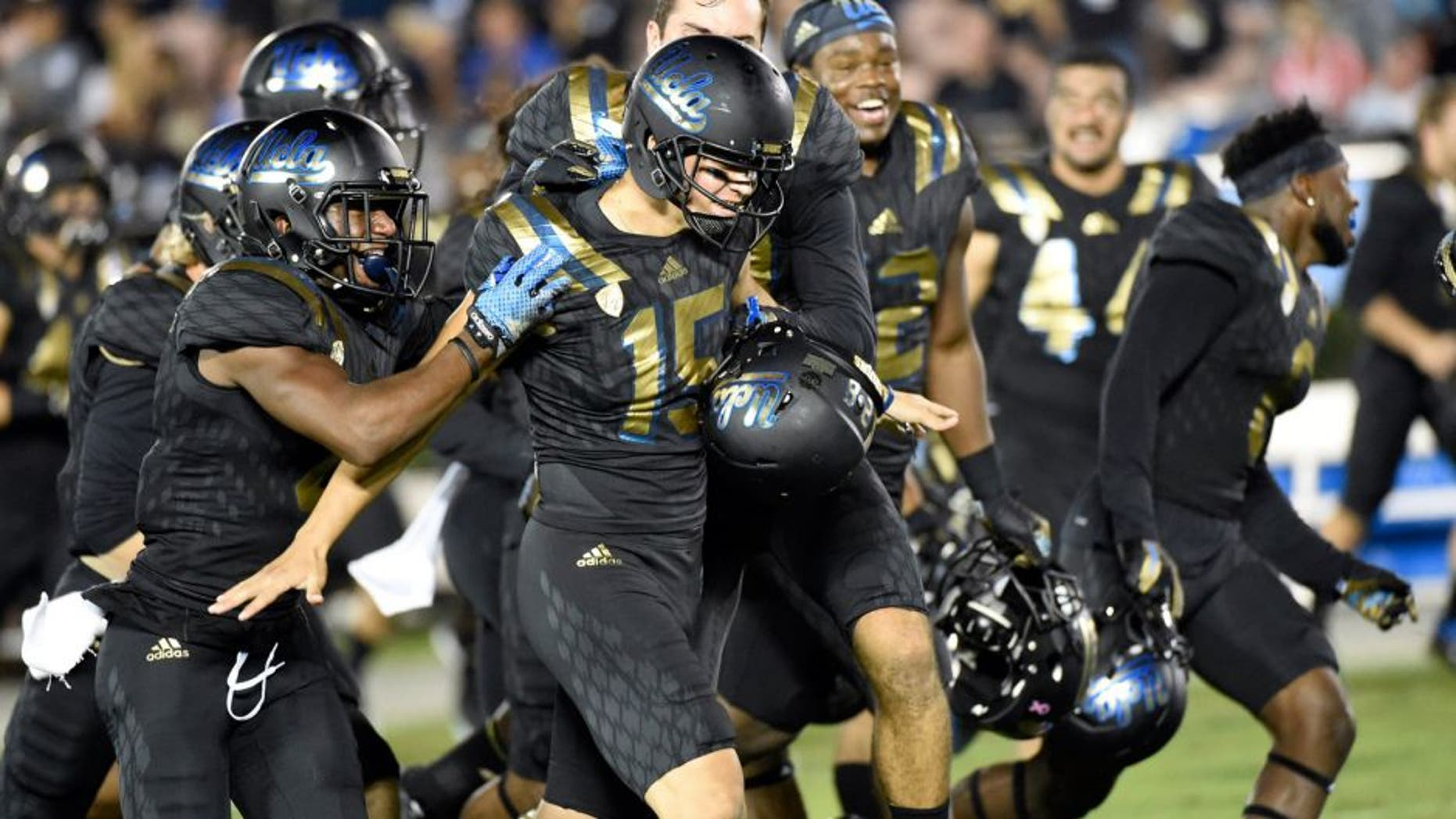 Oct 22, 2015; Pasadena, CA, USA; UCLA Bruins place kicker Ka'imi Fairbairn (15) celebrates making a sixty-yard field goal against the California Golden Bears during the second quarter at Rose Bowl. Mandatory Credit: Richard Mackson-USA TODAY Sports
