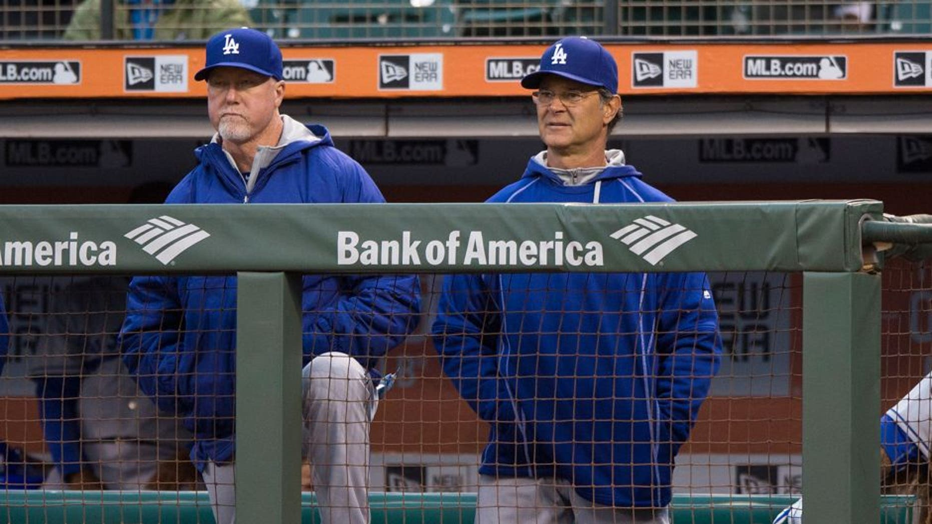 SAN FRANCISCO, CA - APRIL 21: Mark McGwire #25 of the Los Angeles Dodgers and manager Don Mattingly #8 stand in the dugout during the first inning against the San Francisco Giants at AT&T Park on April 21, 2015 in San Francisco, California. The San Francisco Giants defeated the Los Angeles Dodgers 6-2. (Photo by Jason O. Watson/Getty Images)