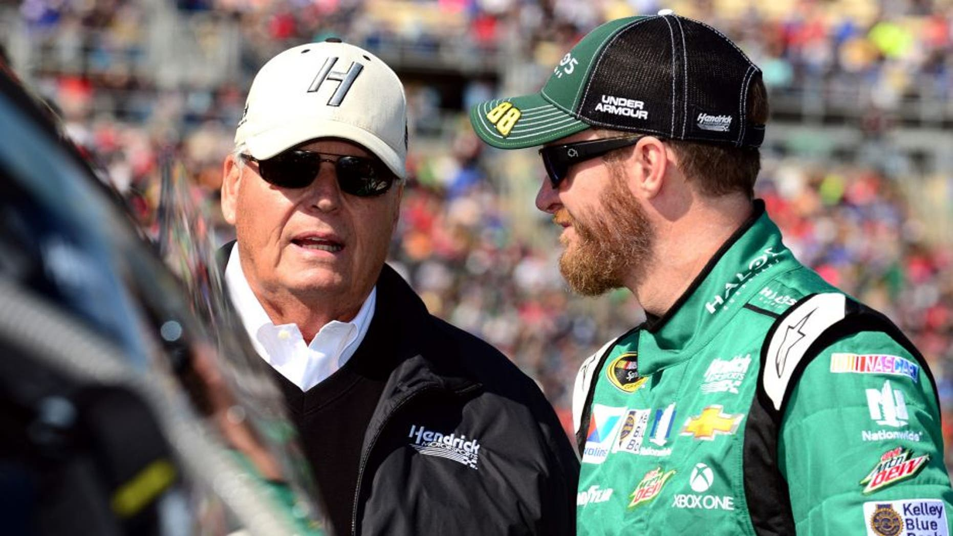 KANSAS CITY, KS - OCTOBER 18: Dale Earnhardt Jr., driver of the #88 Halo 5: Master Chief Chevrolet, talks with Rick Hendrick, owner of Hendrick Motorsports, on the grid prior to the NASCAR Sprint Cup Series Hollywood Casino 400 at Kansas Speedway on October 18, 2015 in Kansas City, Kansas. (Photo by Jeff Curry/Getty Images)