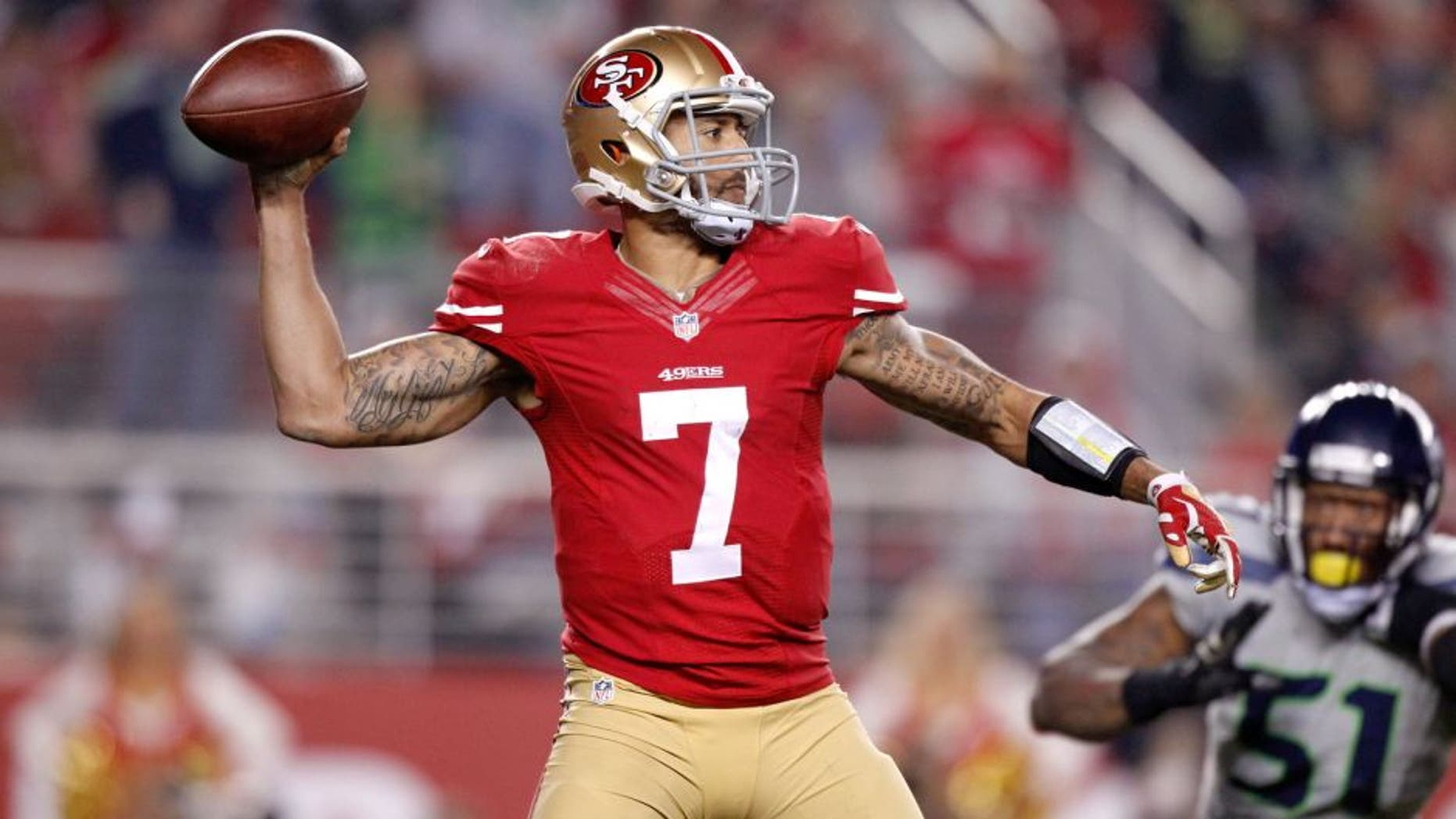 Nov 27, 2014; Santa Clara, CA, USA; San Francisco 49ers quarterback Colin Kaepernick (7) prepares to throw a pass against the Seattle Seahawks in the fourth quarter at Levi's Stadium. The Seahawks defeated the 49ers 19-3. Mandatory Credit: Cary Edmondson-USA TODAY Sports