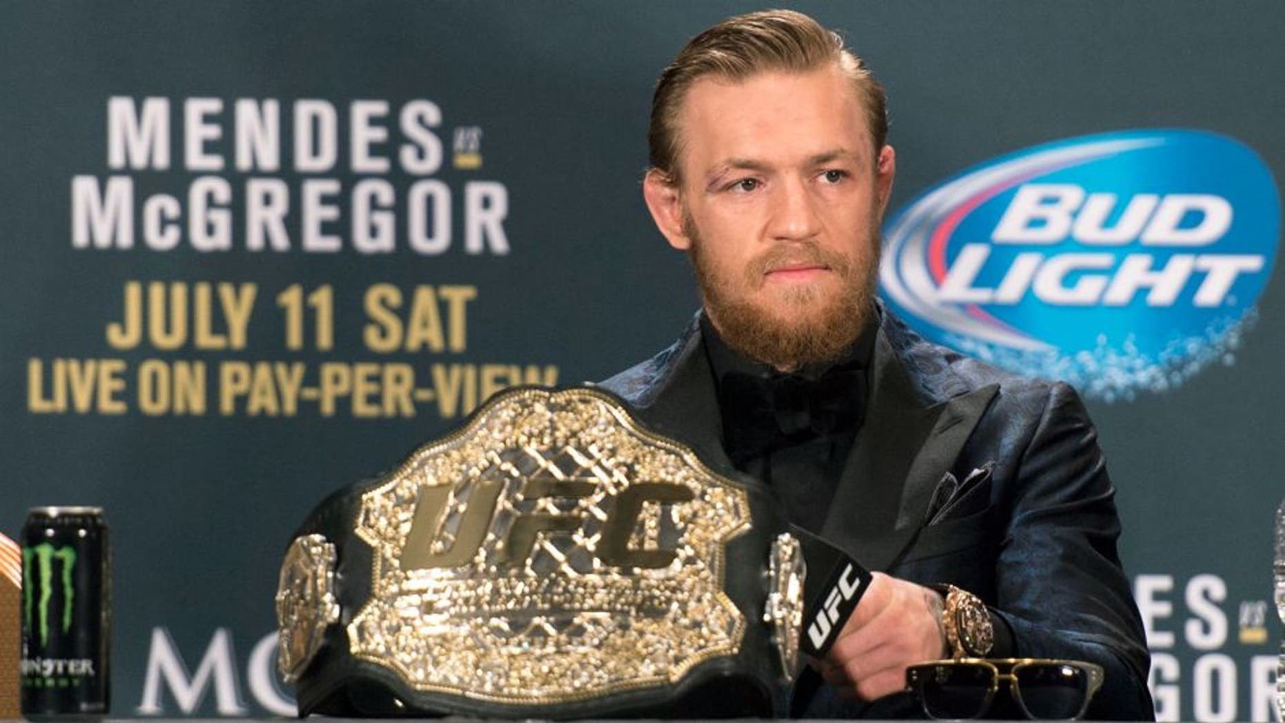 LAS VEGAS, NV - JULY 11: UFC interim featherweight champion Conor McGregor interacts with the media during the UFC 189 post fight press conference at the MGM Grand Garden Arena on July 11, 2015 in Las Vegas, Nevada. (Photo by Jeff Bottari/Zuffa LLC/Zuffa LLC via Getty Images)