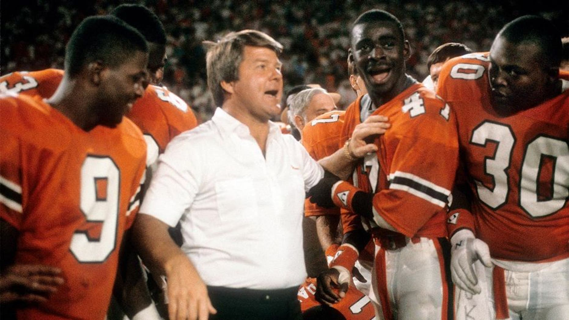 MIAMI, FL - JANUARY 1: Head coach Jimmy Johnson of the #2 rank University of Miami Hurricanes football team with his arm on wide receiver Michael Irvin #47 January 1, 1988 after the NCAA Orange Bowl football Game against the #1 rank Oklahoma University Sooner at the Orange Bowl in Miami, Florida. The Hurricanes won the game 20-14 and became the National Champions. Johnson was the head coach of the Miami Hurricanes from 1984-88. (Photo by Focus on Sport/Getty Images)