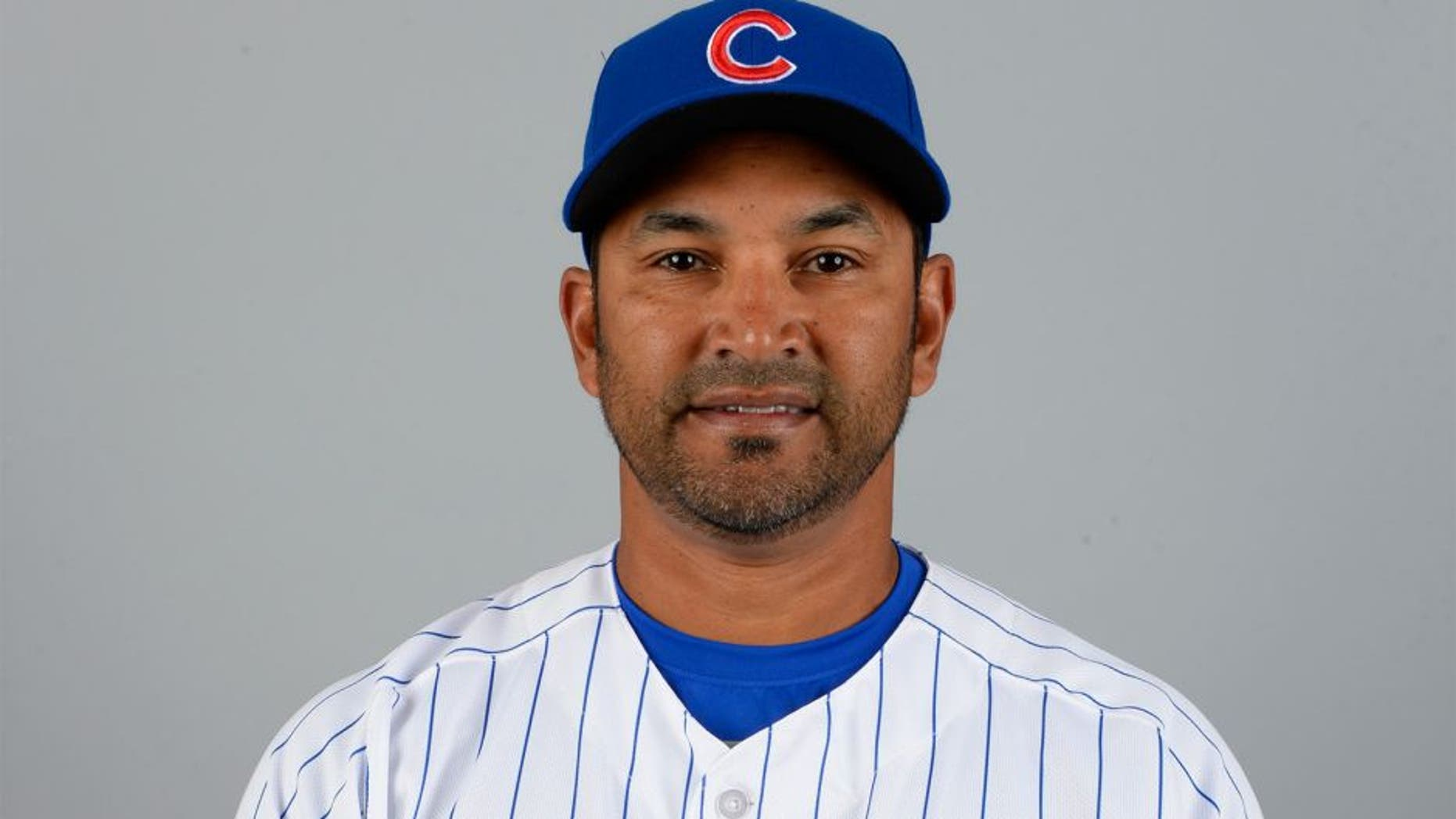 MESA, AZ - MARCH 2: Bench coach Dave Martinez #4 of the Chicago Cubs poses during Photo Day on Monday, March 2, 2015 at Sloan Park in Mesa, Arizona. (Photo by Ron Vesely/MLB Photos via Getty Images)