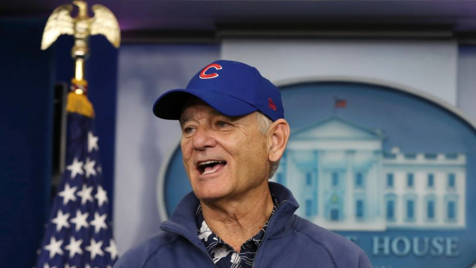 Actor Bill Murray sporting a Chicago Cubs jacket and cap talks during a brief visit in the Brady Press Briefing Room of the White House in Washington, Friday, Oct. 21, 2016. Murray is in Washington to receive the Mark Twain Prize for American Humor. (AP Photo/Manuel Balce Ceneta)