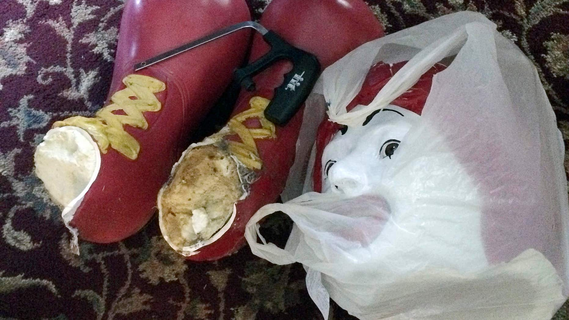 Oct. 22, 2015: This photo provided by Ronald McDonald House Charities, shows the decapitated head and feet from the Ronald McDonald statue that sits on a bench outside the Ronald McDonald House in Burlington, Vt.