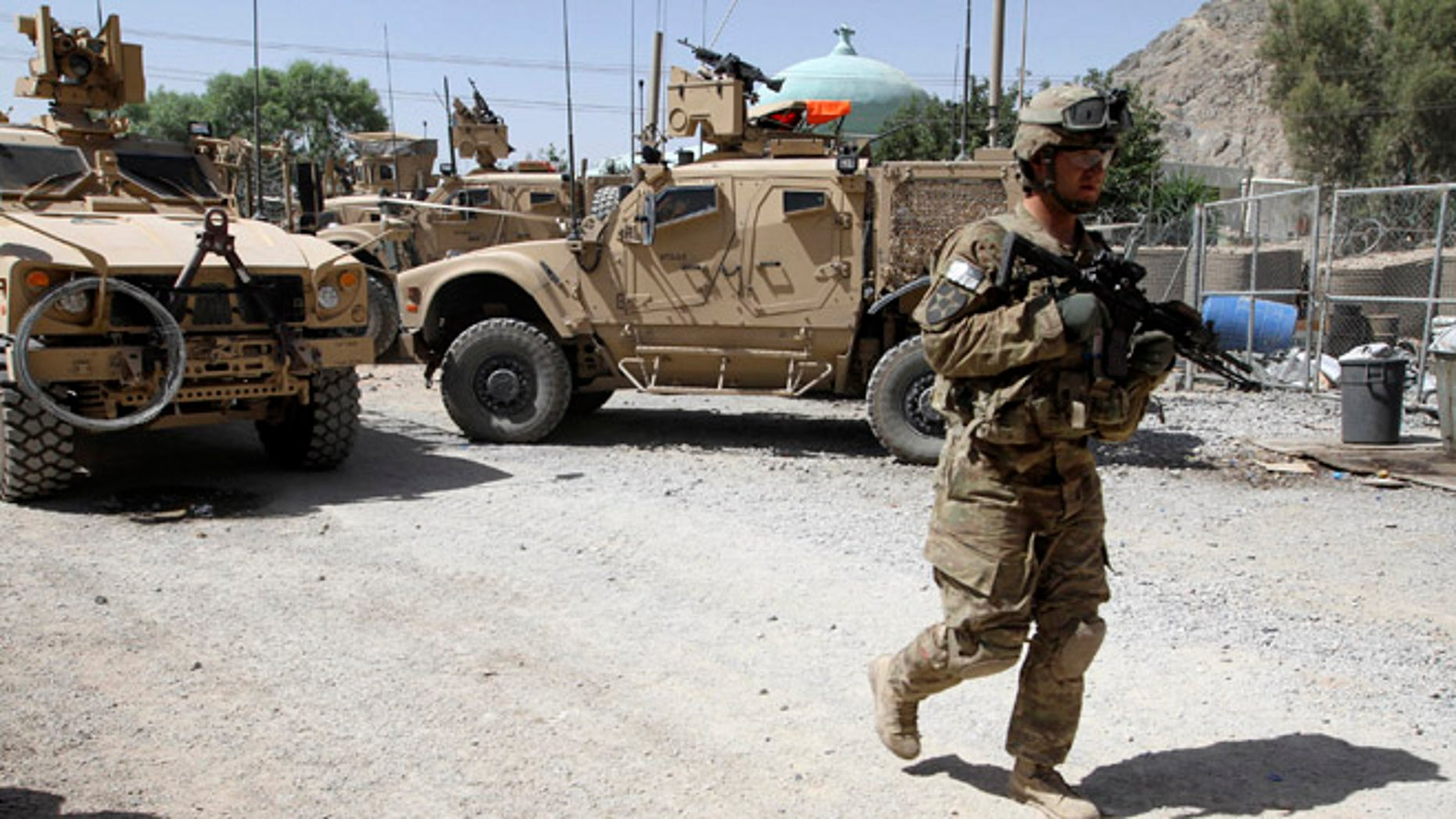 File: June 19, 2012: A US soldier, part of the NATO forces, patrols a police station in Kandahar, south of Kabul, Afghanistan.