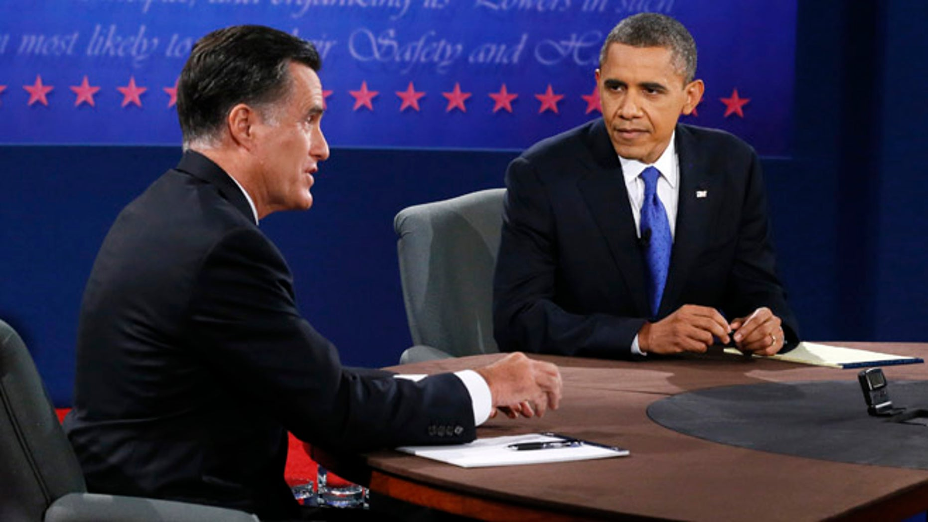 Oct. 22, 2012: President Barack Obama listens as Republican presidential nominee Mitt Romney speaks during the third presidential debate.