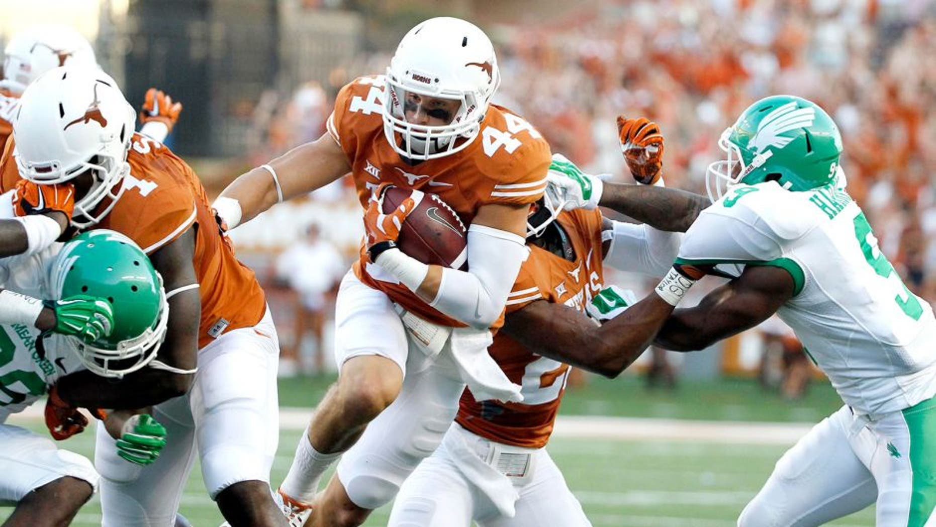 Aug 30, 2014; Austin, TX, USA; Texas Longhorns defensive back Dylan Haines (44) run with the ball after an interception against the North Texas Mean Green during the first half at Darrell K Royal-Texas Memorial Stadium. Mandatory Credit: Soobum Im-USA TODAY Sports