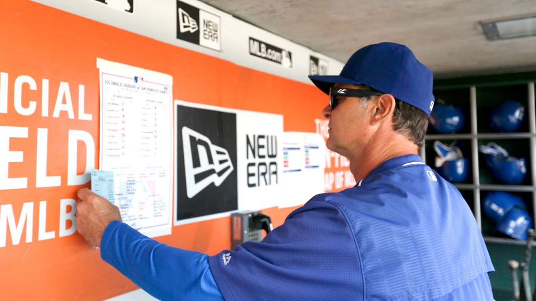SAN FRANCISCO, CA - OCTOBER 1: Manager Don Mattingly #8 of the Los Angeles Dodgers checks the lineup in the dugout prior to the game against theSan Francisco Giants at AT&T Park on October 1, 2015 in San Francisco, California. The Dodgers defeated the Giants 3-2. (Photo by Michael Zagaris/Getty Images)
