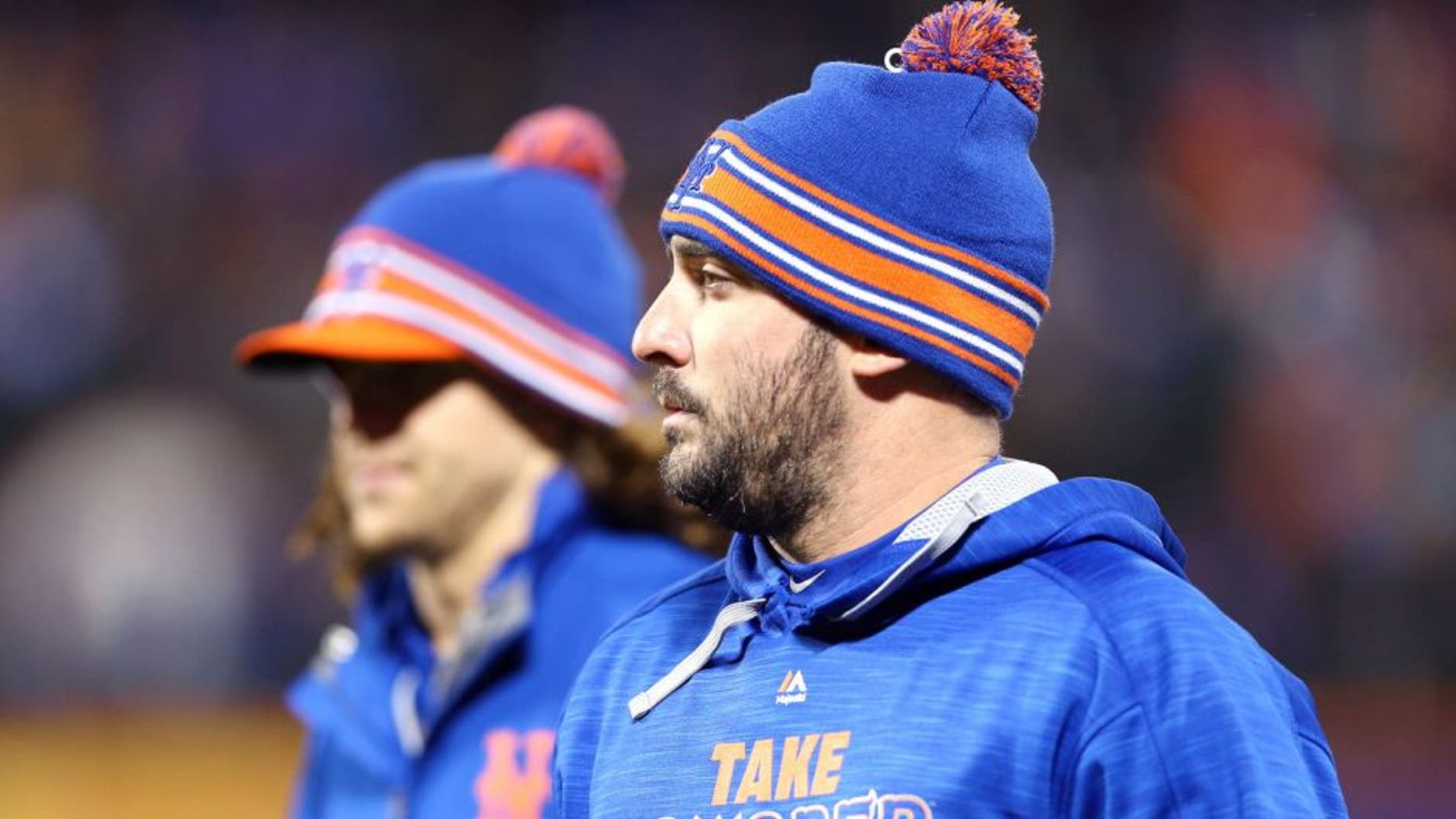 NEW YORK, NY - OCTOBER 18: Matt Harvey #33 and Jacob deGrom #48 of the New York Mets walk on the field prior to game two of the 2015 MLB National League Championship Series against the Chicago Cubs at Citi Field on October 18, 2015 in the Flushing neighborhood of the Queens borough of New York City. (Photo by Elsa/Getty Images)