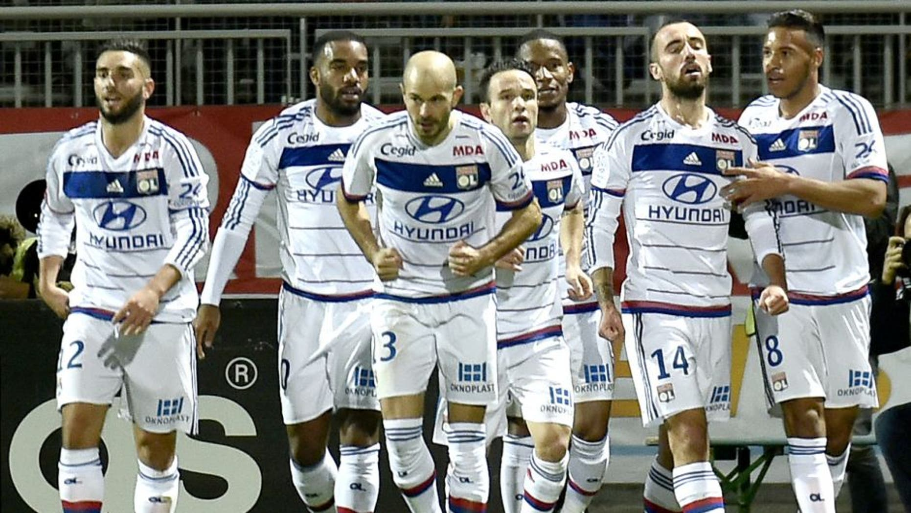 Lyon's Spanish midfielder Sergi Darder (2nd R) celebrates after scoring a goal during the French L1 football match Olympique Lyonnais (OL) vs Toulouse (TFC) on October 23, 2015, at the Gerland Stadium in Lyon, central-eastern France. AFP PHOTO / JEFF PACHOUD (Photo credit should read JEFF PACHOUD/AFP/Getty Images)