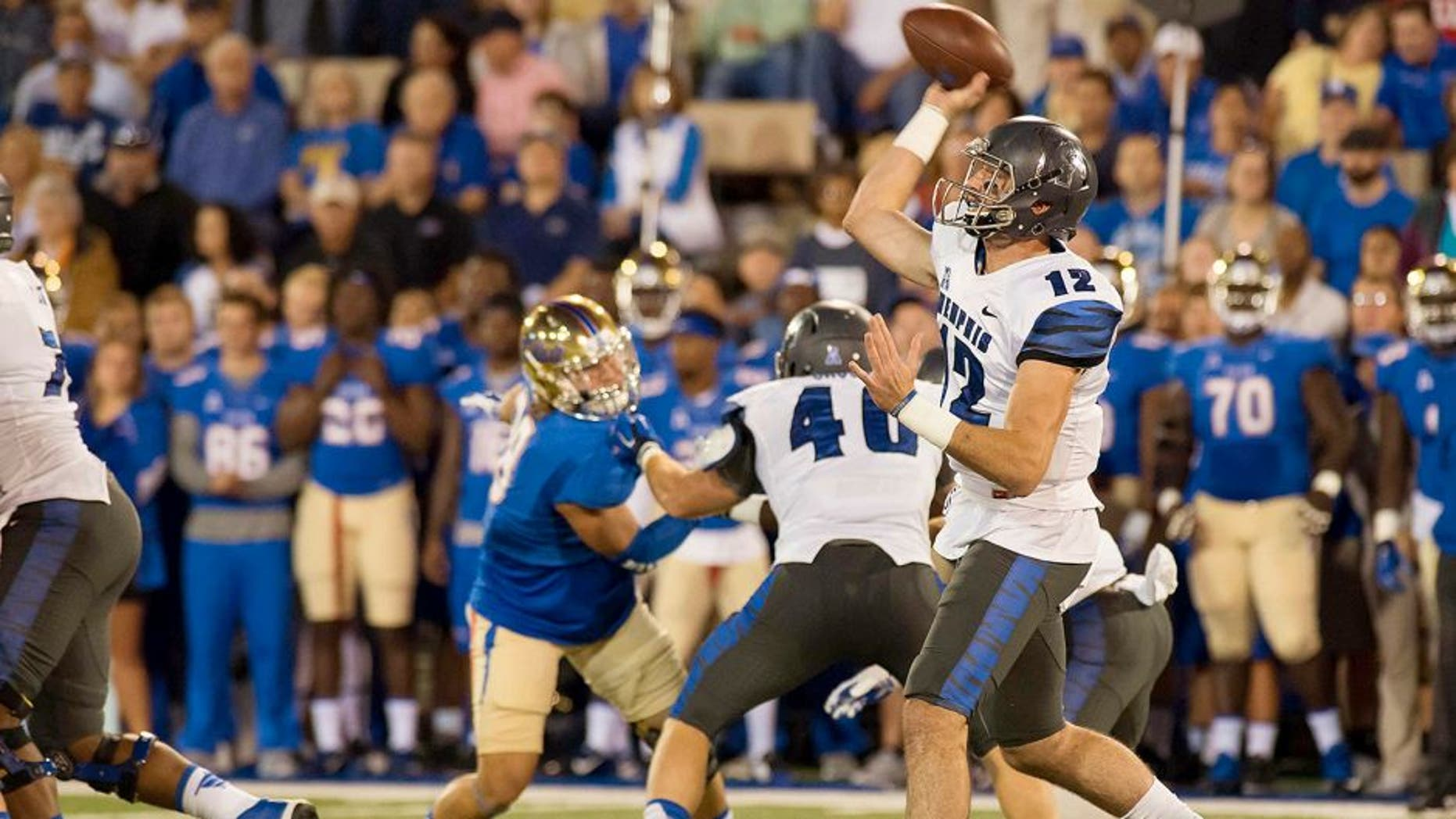 Oct 23, 2015; Tulsa, OK, USA; Memphis Tigers quarterback Paxton Lynch (12) throws the ball against the Tulsa Golden Hurricane during the first quarter at Skelly Field at H.A. Chapman Stadium. Mandatory Credit: Rob Ferguson-USA TODAY Sports