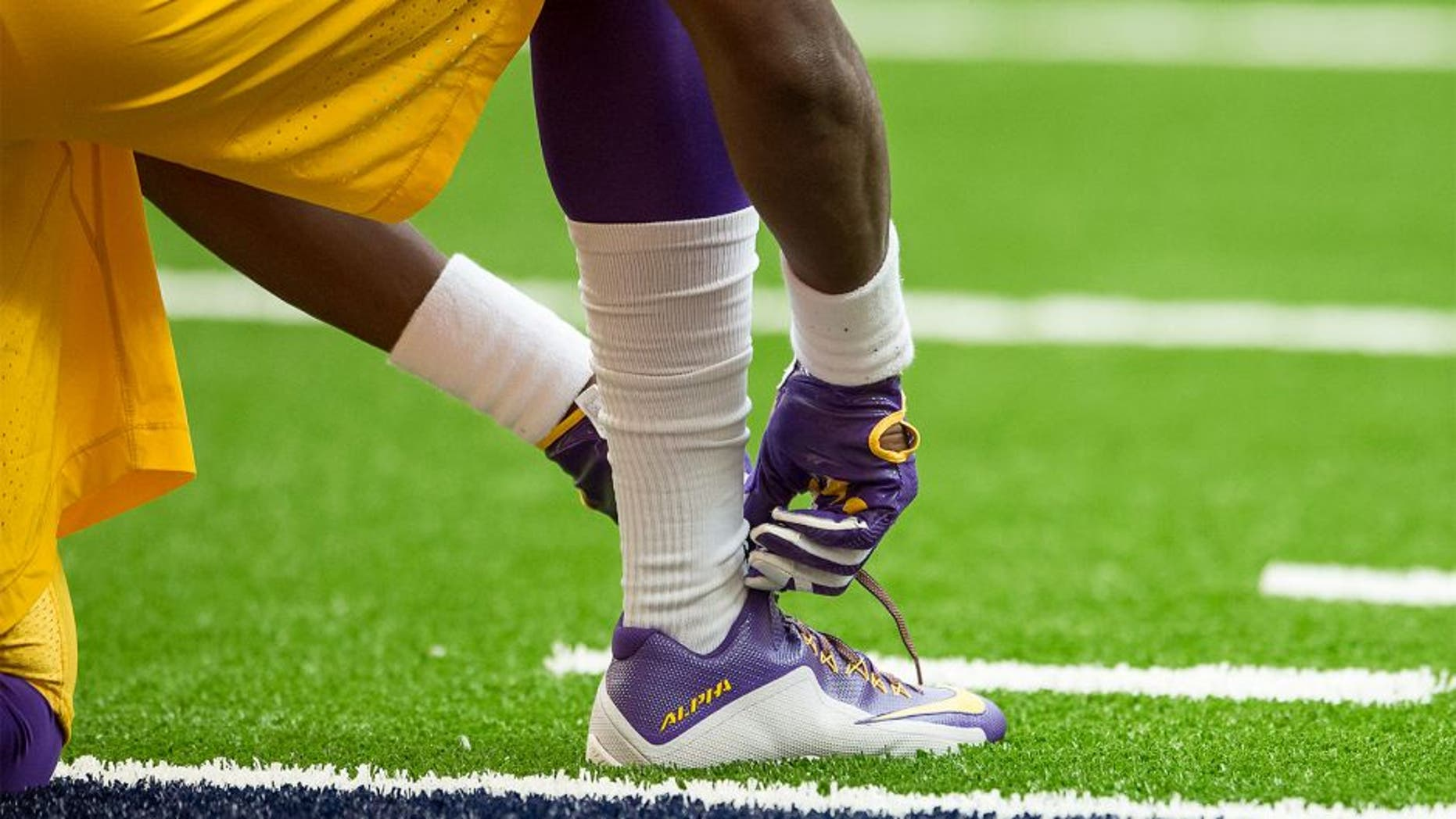 SYRACUSE, NY - SEPTEMBER 26: Nike football cleats worn by LSU Tigers before the game against the Syracuse Orange on September 26, 2015 at The Carrier Dome in Syracuse, New York. LSU defeats Syracuse 34-24. (Photo by Brett Carlsen/Getty Images)