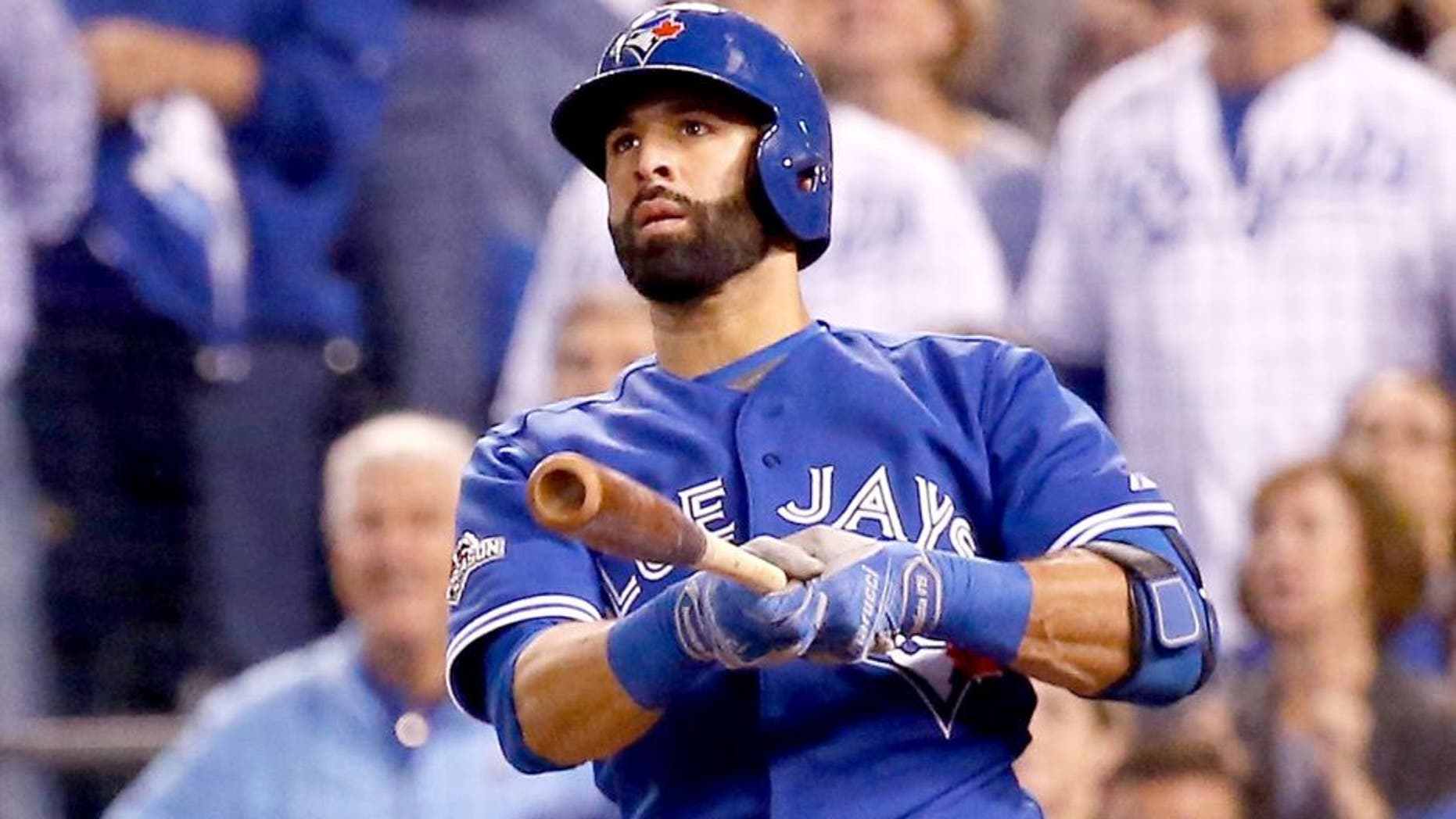 KANSAS CITY, MO - OCTOBER 23: Jose Bautista #19 of the Toronto Blue Jays hits a two-run home run in the eighth inning against the Kansas City Royals in game six of the 2015 MLB American League Championship Series at Kauffman Stadium on October 23, 2015 in Kansas City, Missouri. (Photo by Rob Carr/Getty Images)