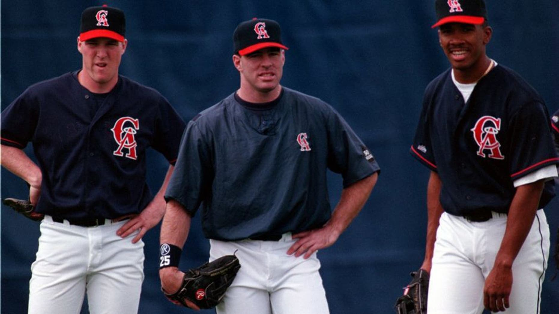 SP.Angel.Outfield.grp.0223.AAGññAngels outfielders during spring training practice (lñR) Darin Erstad, Jim Edmonds, and Garret Anderson. (Photo by Alex Garcia/Los Angeles Times via Getty Images)