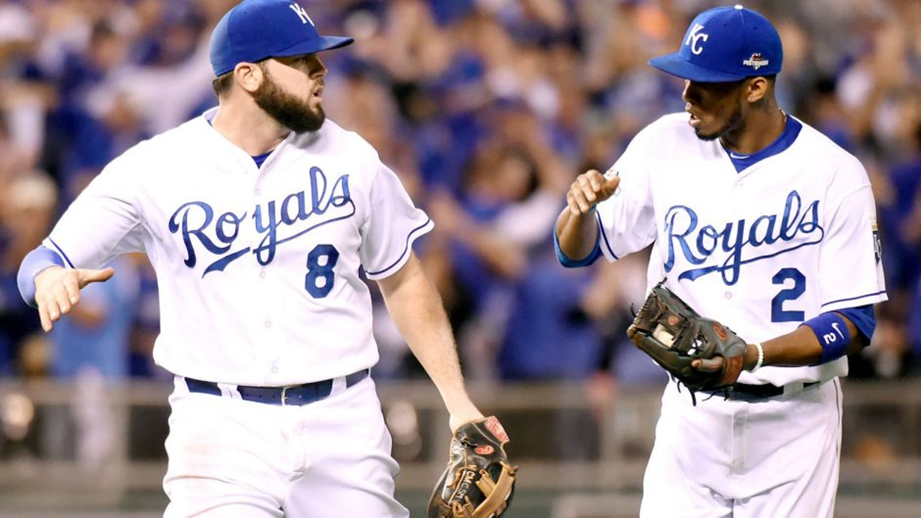 KANSAS CITY, MO - OCTOBER 23: Mike Moustakas #8 and Alcides Escobar #2 of the Kansas City Royals celebrate the end of an inning during Game 6 of the ALCS against the Toronto Blue Jays at Kauffman Stadium on Friday, October 23, 2015 in Kansas City Missouri. (Photo by LG Patterson/MLB Photos via Getty Images)