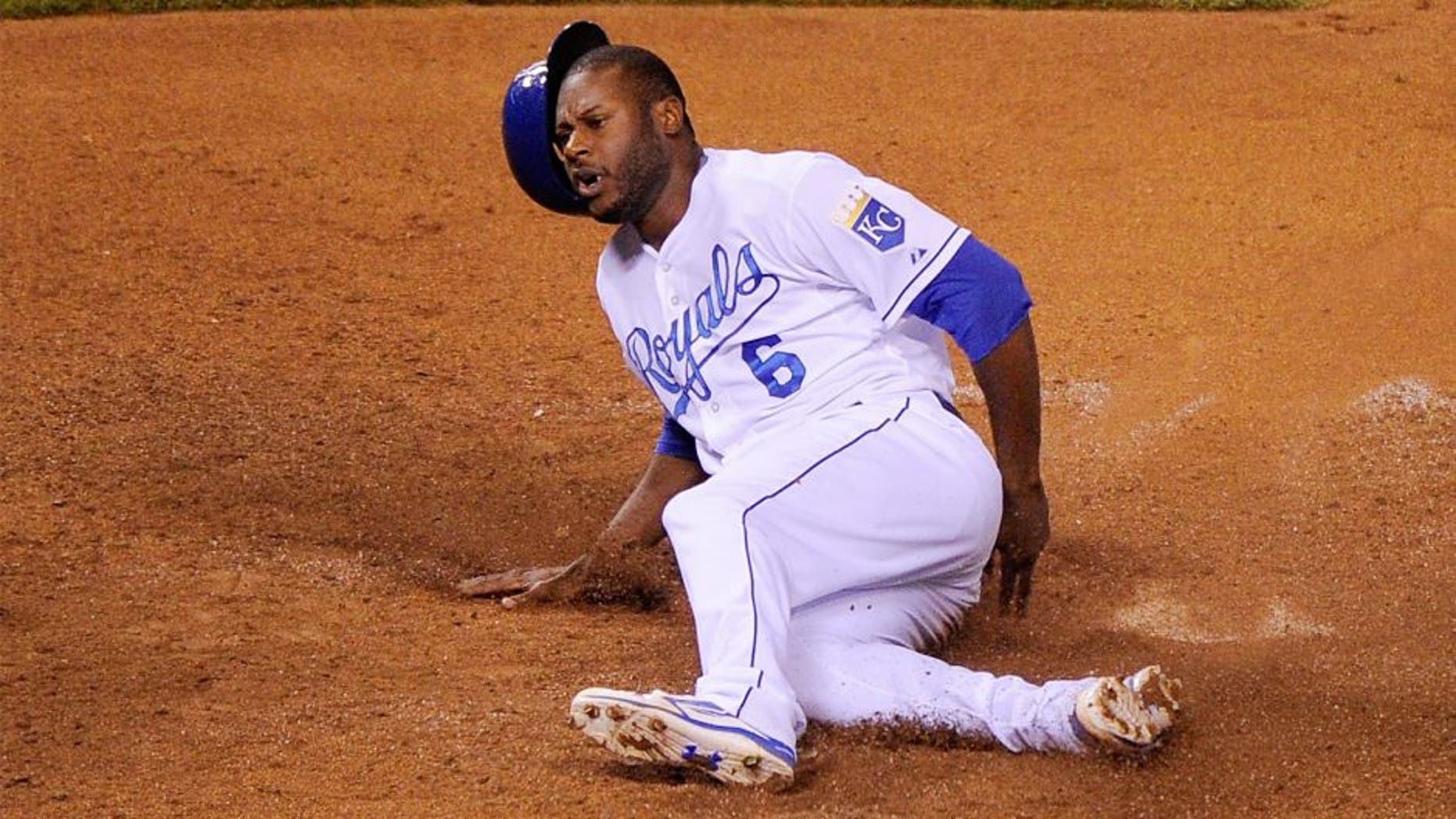 KANSAS CITY, MO - OCTOBER 23: Lorenzo Cain #6 of the Kansas City Royals slides safely to score in the eighth inning against the Toronto Blue Jays in game six of the 2015 MLB American League Championship Series at Kauffman Stadium on October 23, 2015 in Kansas City, Missouri. (Photo by Ed Zurga/Getty Images)