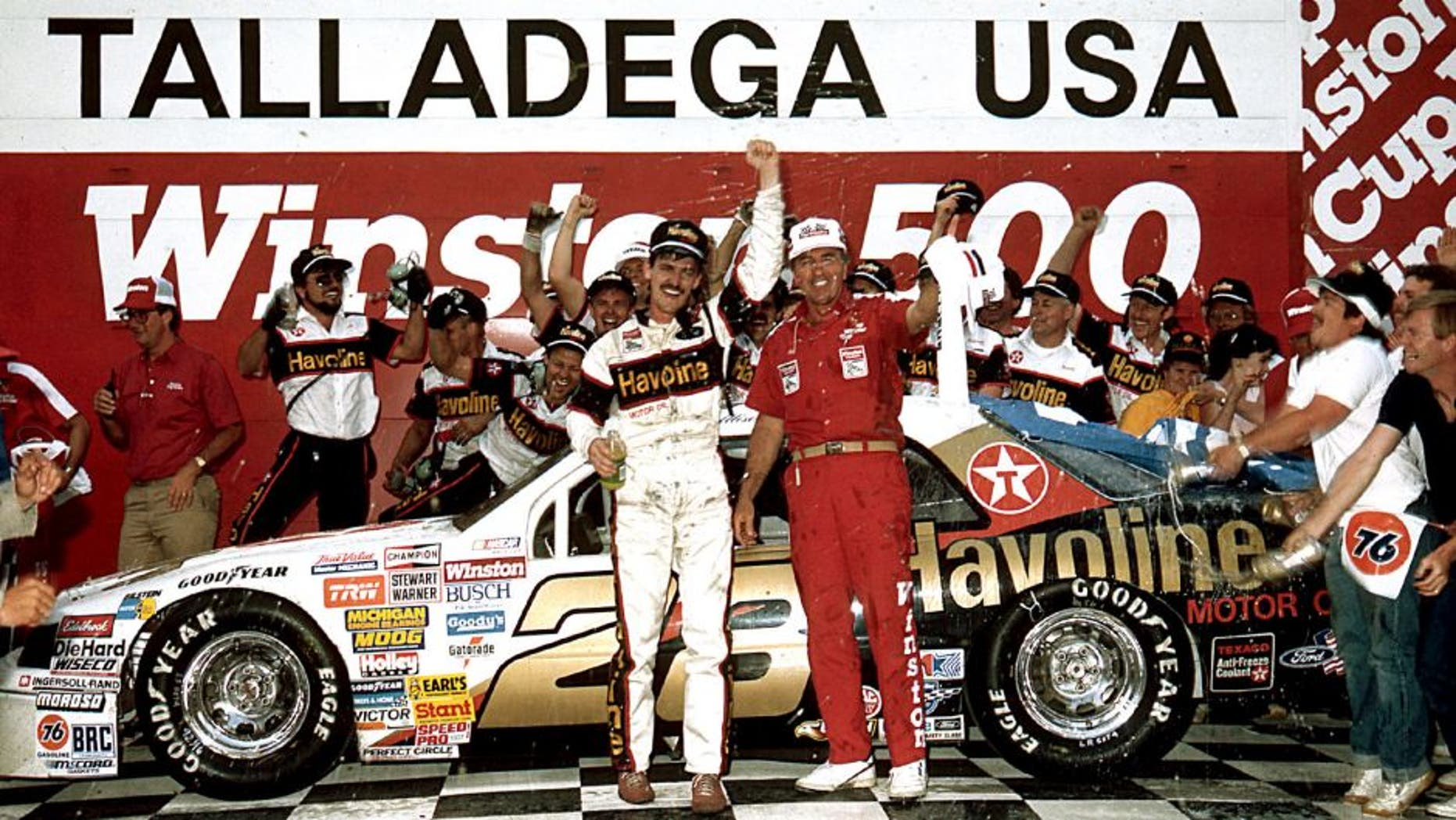 TALLADEGA, AL - MAY 3, 1987: Davey Allison and his crew celebrate in victory lane following their win in the Winston 500 at Alabama International Motor Speedway. It was Allison's first career NASCAR Cup victory. (Photo by ISC Images & Archives via Getty Images)