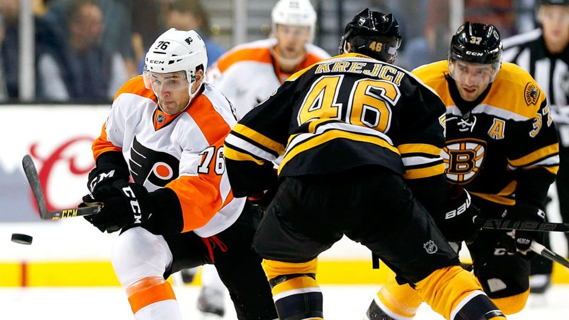 Oct 21, 2015; Boston, MA, USA; Philadelphia Flyers center Chris VandeVelde (76) tries to get past Boston Bruins center David Krejci (46) during the second period of the Philadelphia Flyers 5-4 overtime win over the Boston Bruins at TD Garden. Mandatory Credit: Winslow Townson-USA TODAY Sports