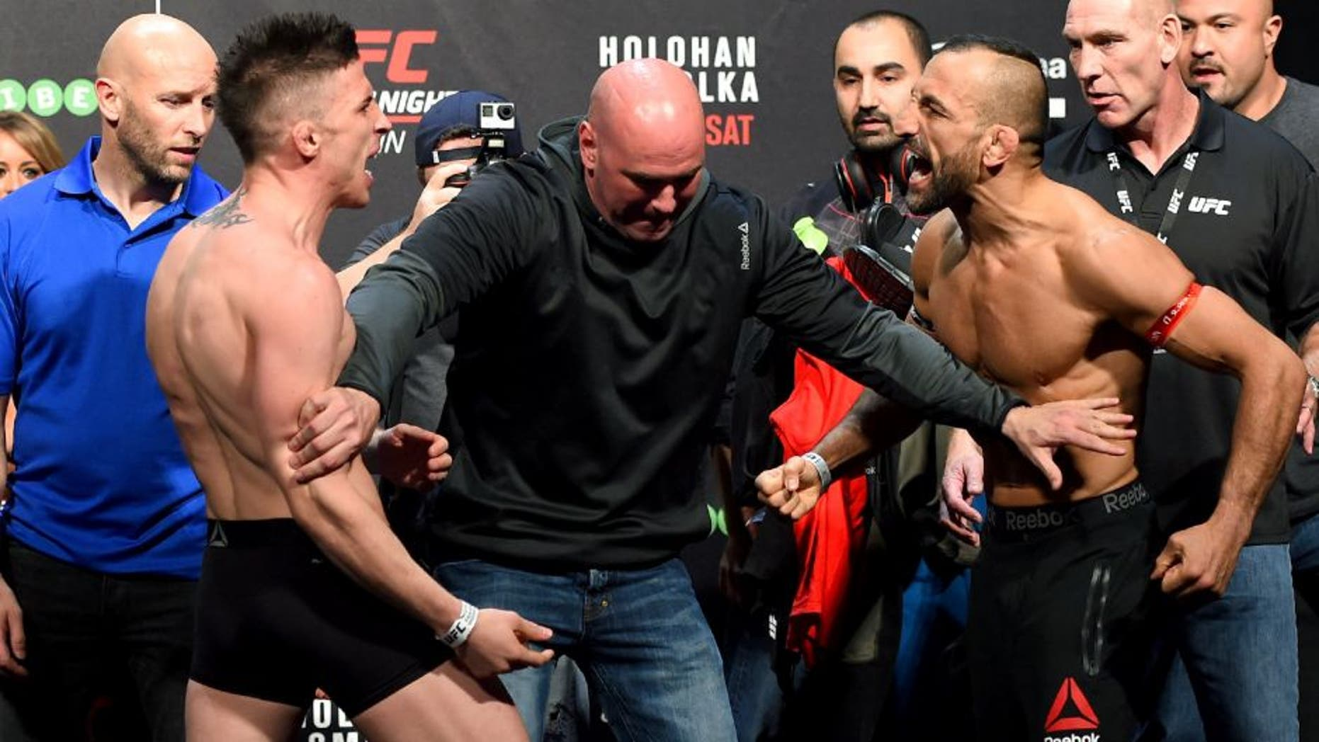DUBLIN, IRELAND - OCTOBER 23: (L-R) Opponents Norman Parke of Northern Ireland and Reza Madadi of Sweden face off during the UFC weigh-in at 3Arena on October 23, 2015 in Dublin, Ireland. (Photo by Josh Hedges/Zuffa LLC/Zuffa LLC via Getty Images)