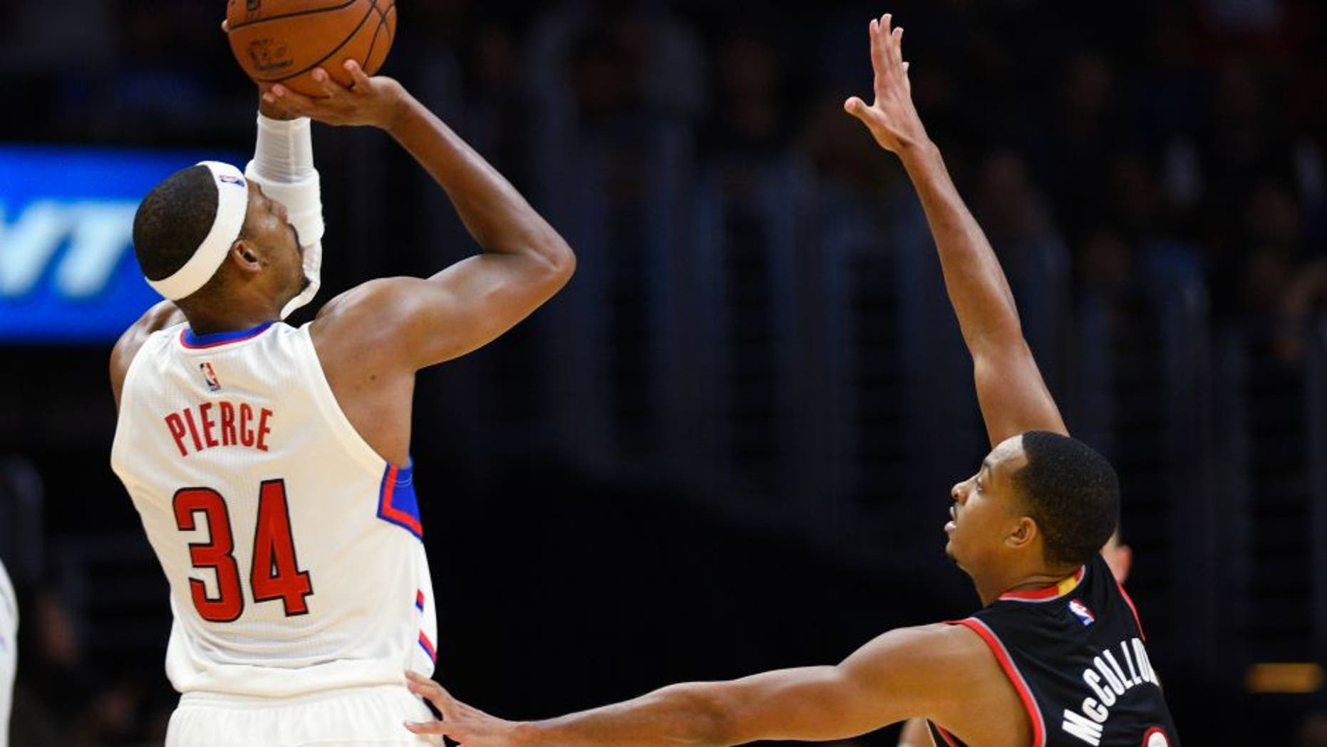 Los Angeles Clippers' Paul Pierce shoots as Portland Trail Blazers' CJ McCollum defends during the fourth quarter of an NBA preseason basketball game in Los Angeles, Thursday, Oct. 22, 2015. The Clippers won 115-109. (AP Photo/Kelvin Kuo)