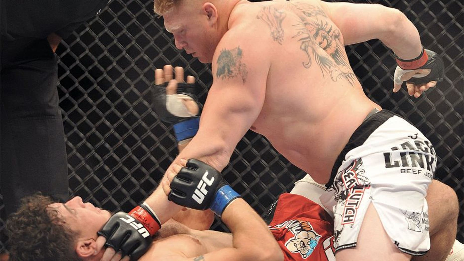 LAS VEGAS - JULY 11: UFC heavyweights Brock Lesnar (R) battles Frank Mir (L) during their heavyweight title bout during UFC 100 the Mandalay Bay Hotel and Casino on July 11, 2009 in Las Vegas, Nevada. (Photo by Jon Kopaloff/Getty Images)