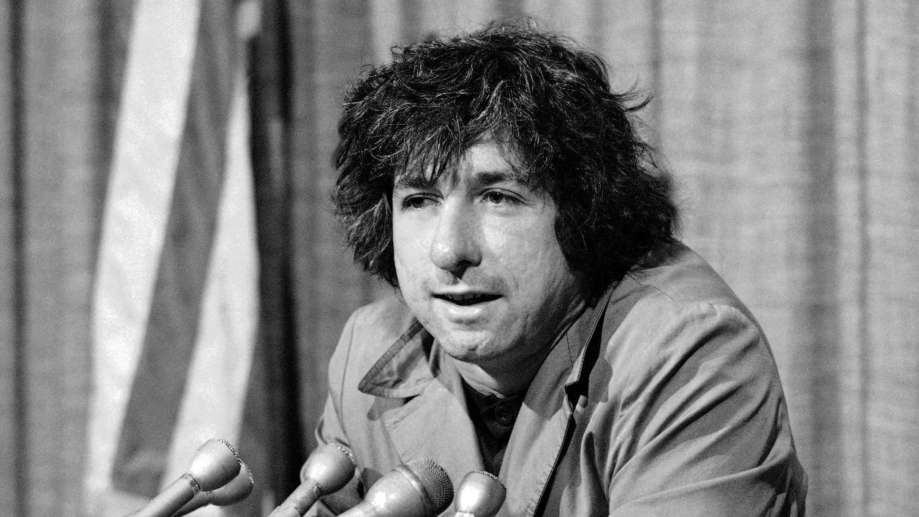 FILE - In this Dec. 6, 1973 file photo, political activist Tom Hayden, husband of Jane Fonda, tells newsmen in Los Angeles that he believes public support was partially responsible for the decision not to send him and others of the Chicago 7 to jail for contempt.