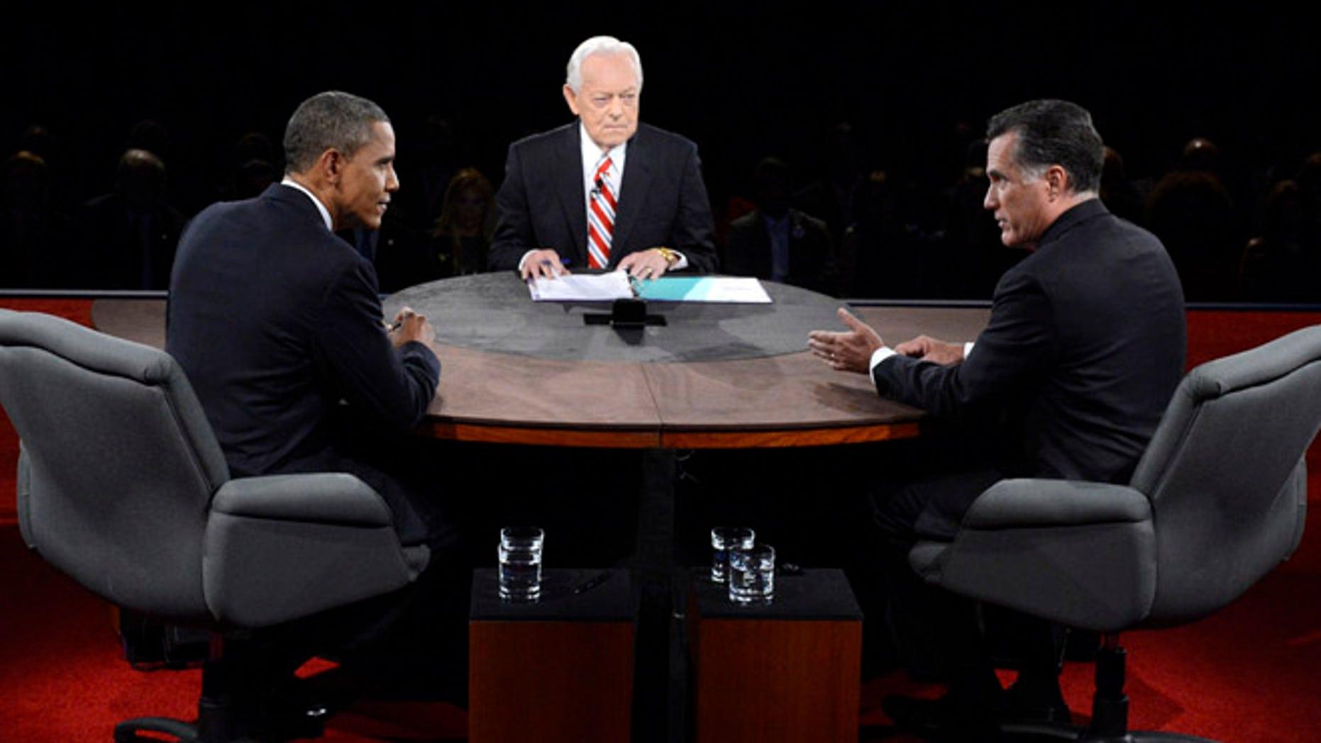 FILE: Oct. 22, 2012: President Obama and moderator Bob Schieffer listen as Republican presidential nominee Mitt Romney speaks during the third presidential debate.