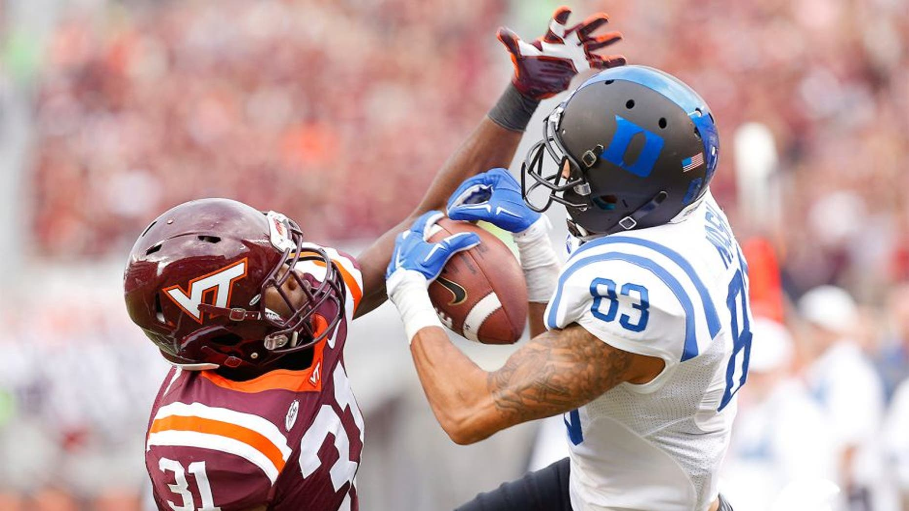 Oct 24, 2015; Blacksburg, VA, USA; Duke Blue Devils wide receiver Anthony Nash (83) attempts to catch the ball as Virginia Tech Hokies cornerback Brandon Facyson (31) defends in the second quarter at Lane Stadium. Mandatory Credit: Geoff Burke-USA TODAY Sports