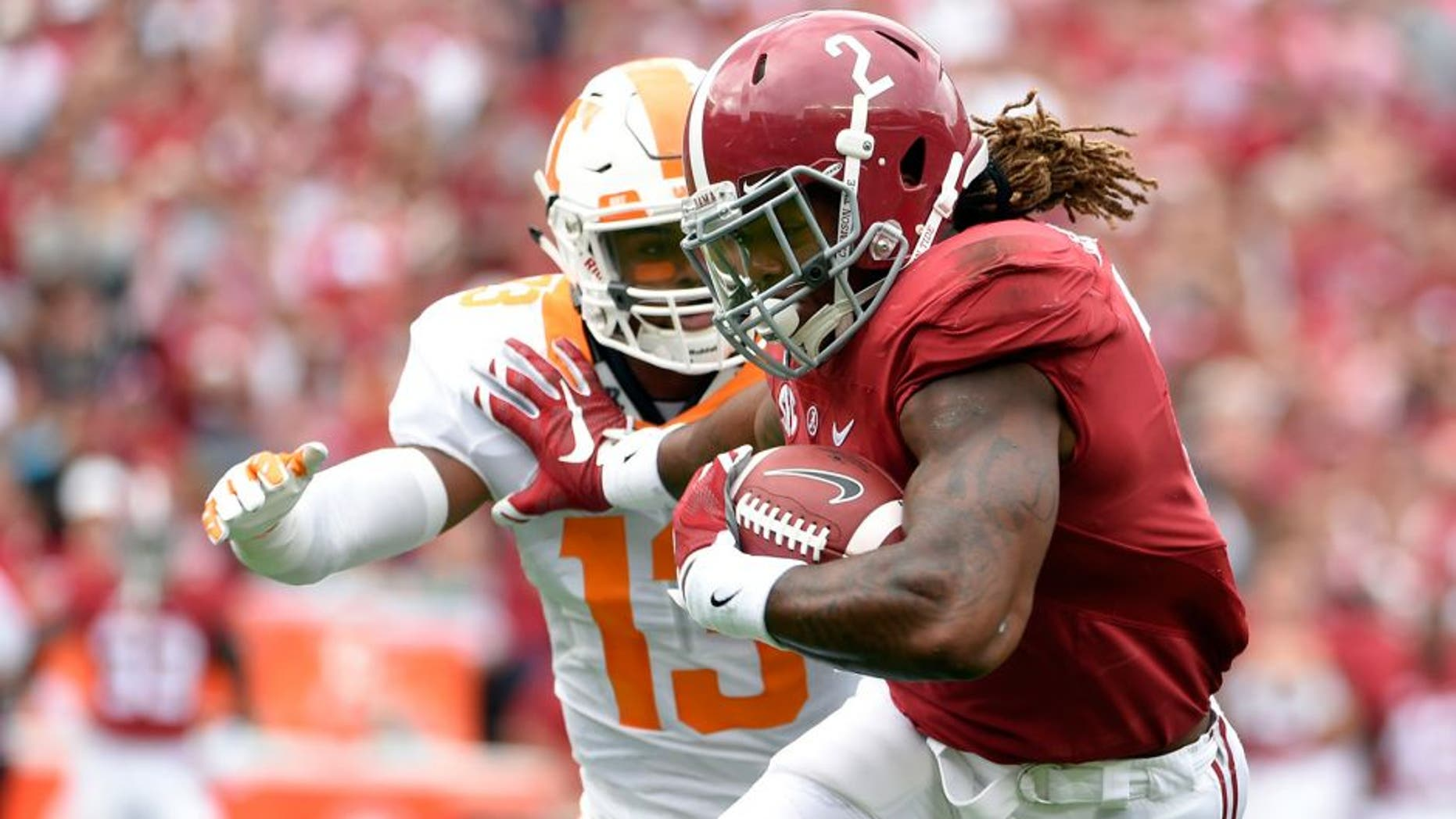 Oct 24, 2015; Tuscaloosa, AL, USA; Alabama Crimson Tide running back Derrick Henry (2) carries for a touchdown against Tennessee Volunteers defensive back Malik Foreman (13) during the first quarter at Bryant-Denny Stadium. Mandatory Credit: John David Mercer-USA TODAY Sports