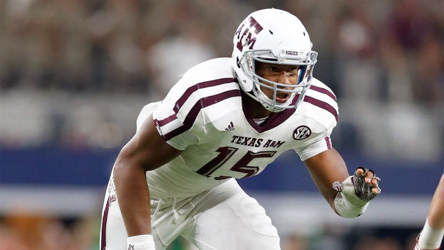 Sep 26, 2015; Arlington, TX, USA; Texas A&M Aggies defensive lineman Myles Garrett (15) in action against the Arkansas Razorbacks at AT&T Stadium. Mandatory Credit: Matthew Emmons-USA TODAY Sports