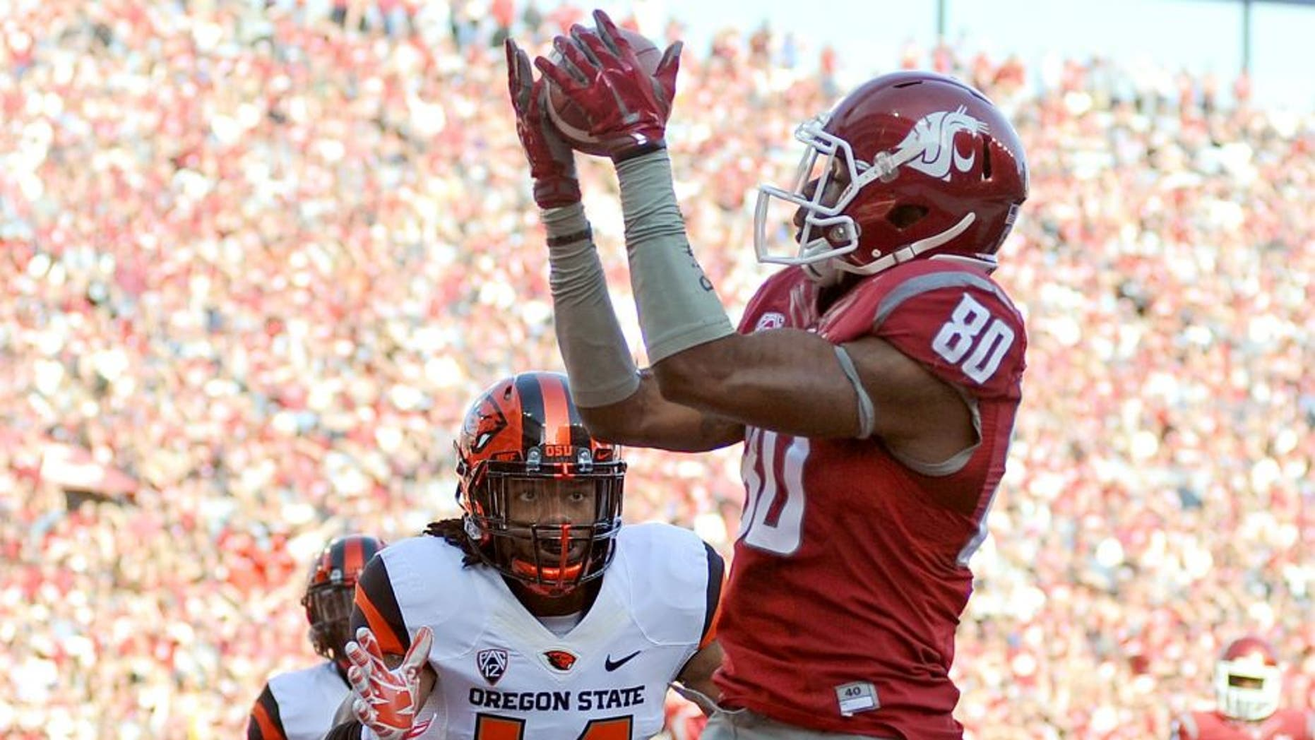 Oct 17, 2015; Pullman, WA, USA; Washington State Cougars wide receiver Dom Williams (80) makes a touchdown catch against Oregon State Beavers cornerback Treston Decoud (14) during the first half at Martin Stadium. Mandatory Credit: James Snook-USA TODAY Sports