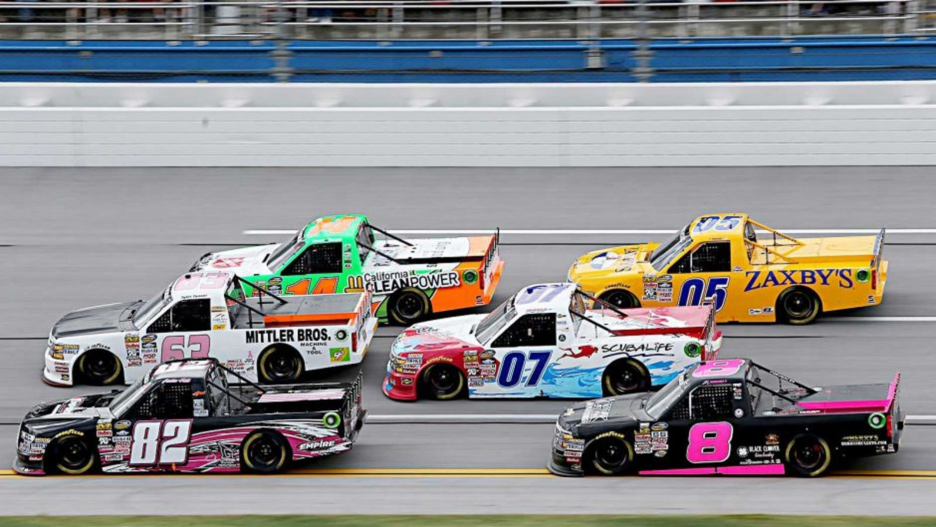 TALLADEGA, AL - OCTOBER 24: Austin Hill, driver of the #82 EmpireRacingDriverDevelopment/B.R.A.K.E.S Ford, and Tyler Tanner, driver of the #63 Mittler Bros./Ski Soda Chevrolet, lead a pack of trucks during the NASCAR Camping World Truck Series fred's 250 at Talladega Superspeedway on October 24, 2015 in Talladega, Alabama. (Photo by Jerry Markland/Getty Images)