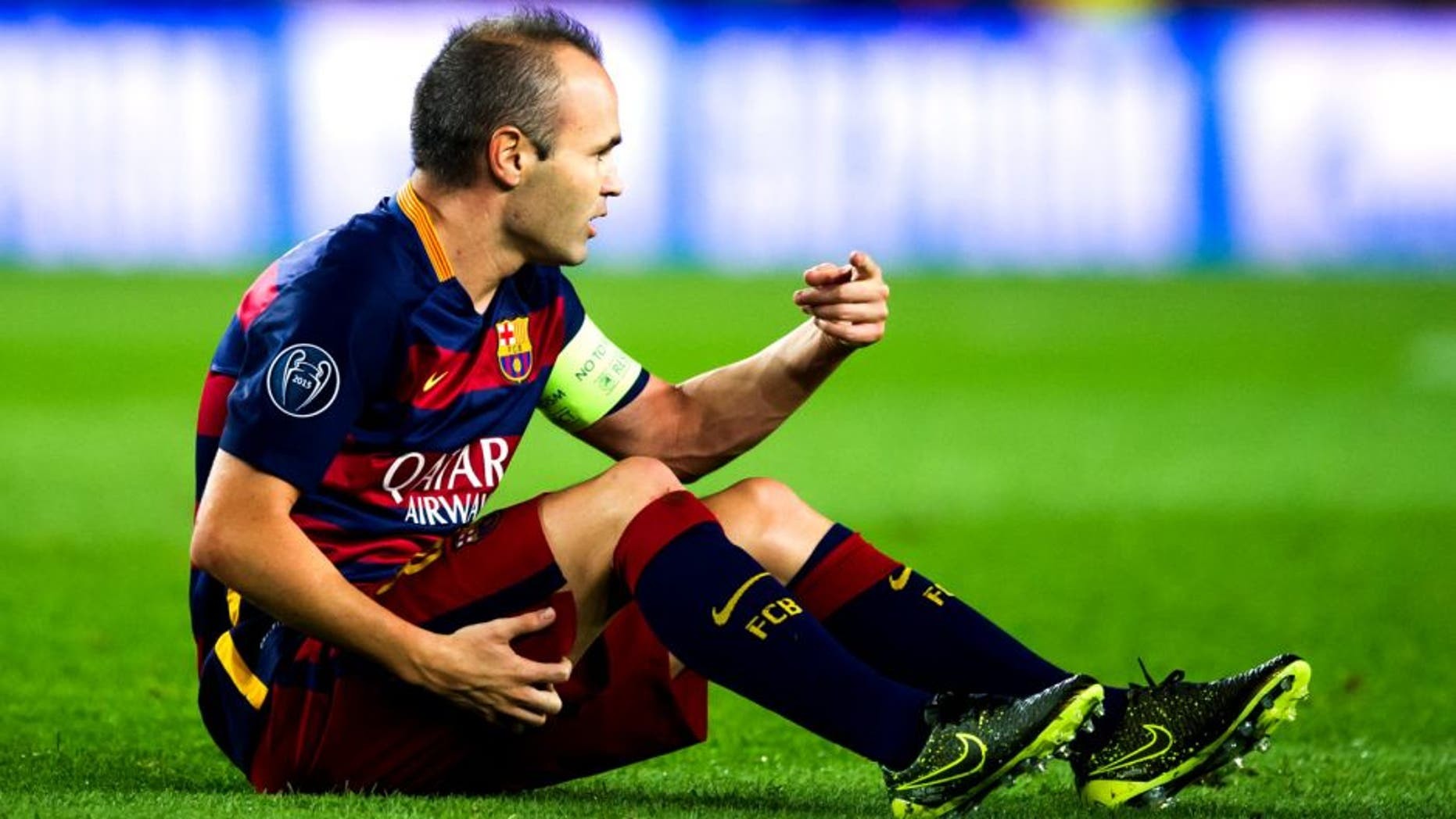 BARCELONA, SPAIN - SEPTEMBER 29: Andres Iniesta of FC Barcelona asks to his bench to be substituted as he lays injured during the UEFA Champions League Group E match between FC Barcelona and Bayern 04 Leverkusen at Camp Nou on September 29, 2015 in Barcelona, Spain. (Photo by Alex Caparros/Getty Images)