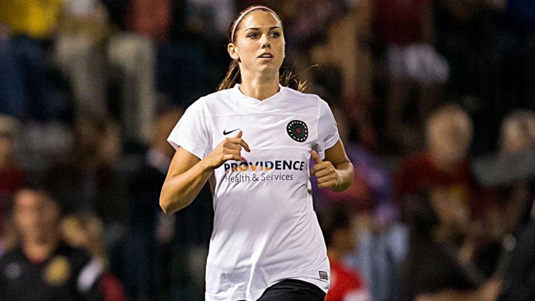 ROCHESTER, NY - AUGUST 31: Alex Morgan #13 of Portland Thorns FC enters the game against Western New York Flash during the second period despite a left knee injury in the National Women's Soccer League Championship at Sahlen's Stadium August 31, 2013 in Rochester, New York. (Photo by Brett Carlsen/Getty Images)