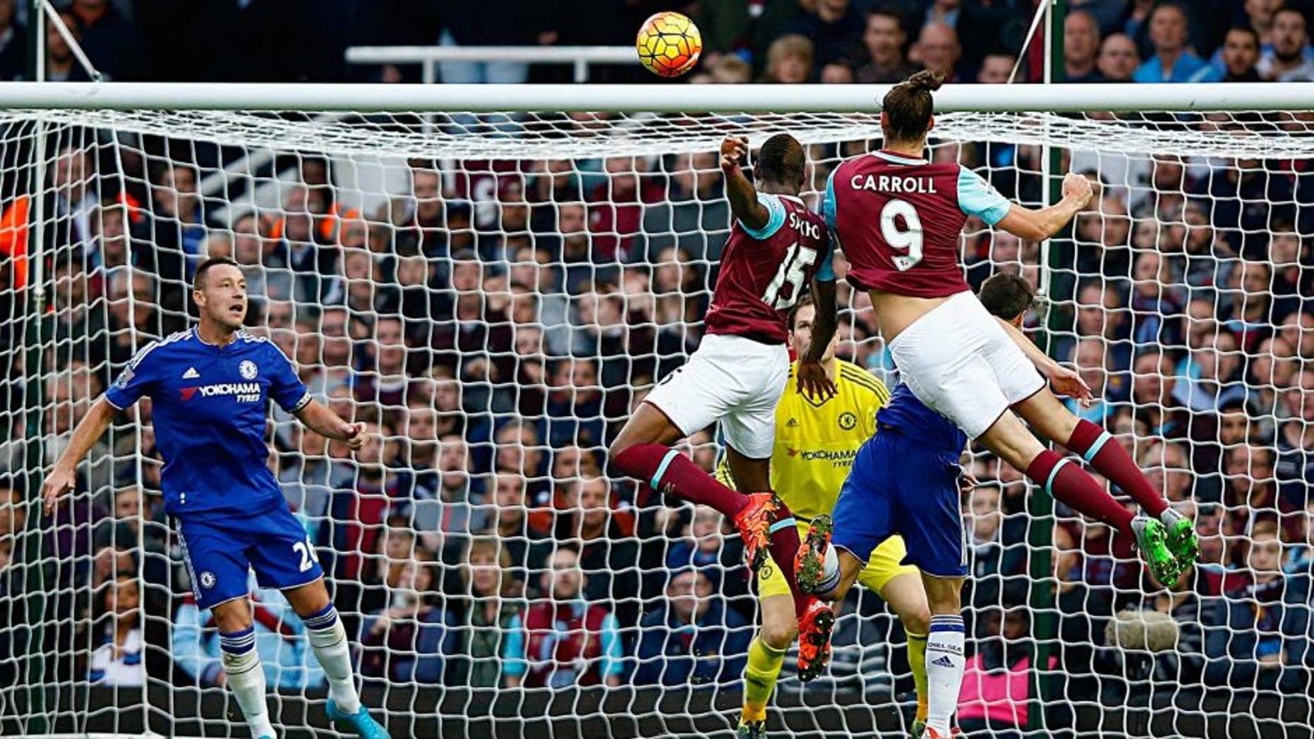 LONDON, ENGLAND - OCTOBER 24: Andy Carroll #9 of West Ham United scores his team's second goal during the Barclays Premier League match between West Ham United and Chelsea at Boleyn Ground on October 24, 2015 in London, England. (Photo by Clive Rose/Getty Images)