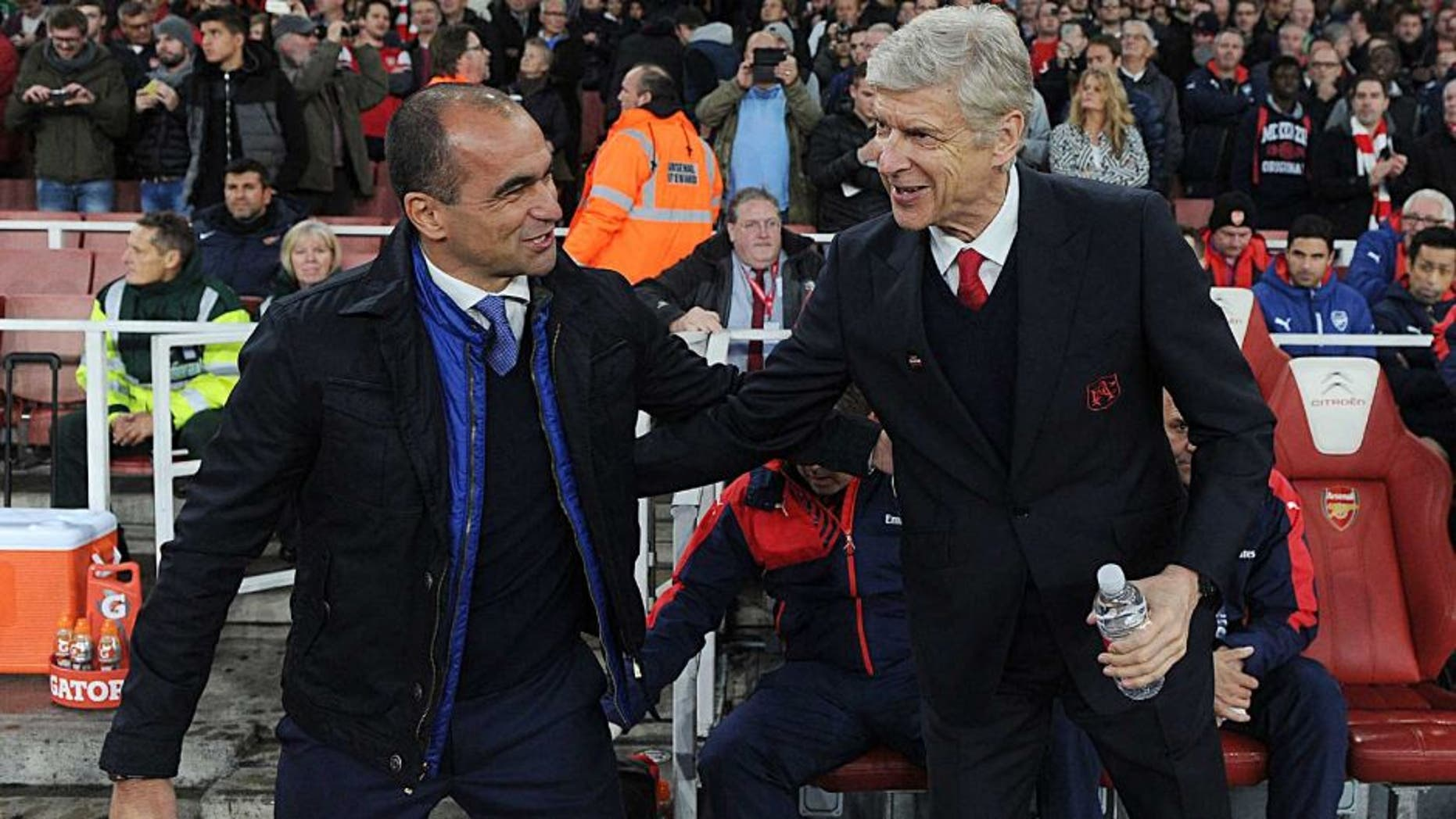 LONDON, ENGLAND - OCTOBER 24: Arsene Wenger the Arsenal Manager with Roberto Martinez the Everton Manager before the Barclays Premier League match between Arsenal and Everton at Emirates Stadium on October 24, 2015 in London, England. (Photo by David Price/Arsenal FC via Getty Images)