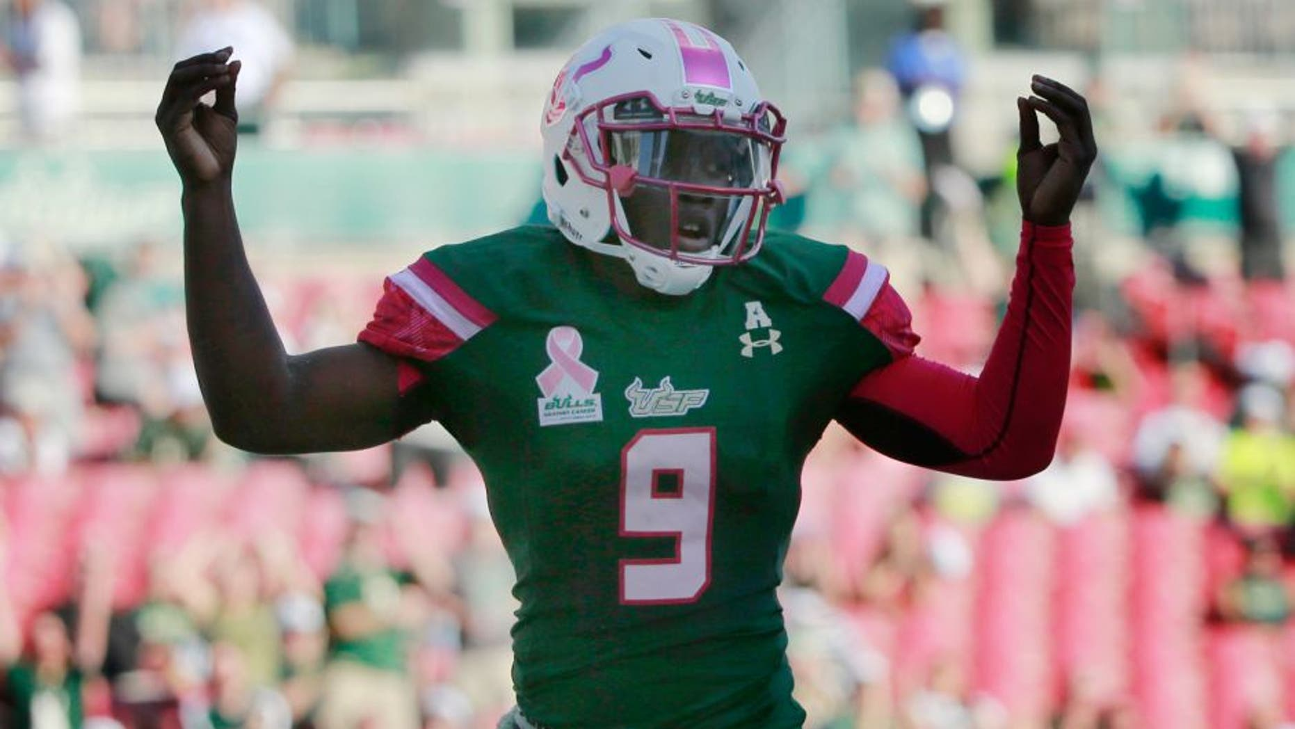 Oct 24, 2015; Tampa, FL, USA; South Florida Bulls quarterback Quinton Flowers (9) celebrates as he scores a touchdown against the Southern Methodist Mustangs during the first quarter at Raymond James Stadium. Mandatory Credit: Kim Klement-USA TODAY Sports