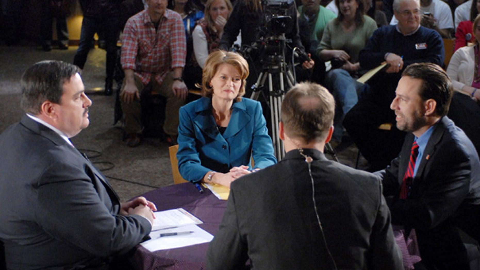 Oct. 24: U.S. Senate Democratic candidate Scott McAdams, left, write-in candidate Sen. Lisa Murkowski, center, and Republican candidate Joe Miller debate in Anchorage.