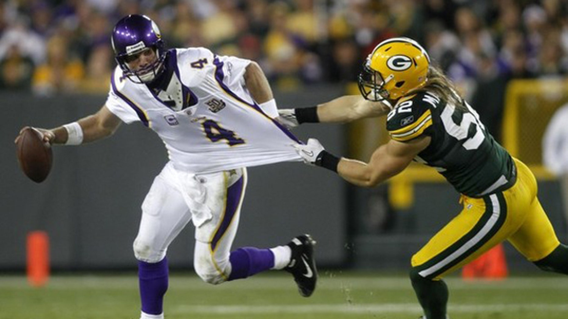 Oct. 24: Green Bay Packers linebacker Clay Matthews (52) attempts to tackle Minnesota Vikings quarterback Brett Favre (4) in the fourth quarter of their NFL football game at Lambeau Field Green Bay, Wisconsin.