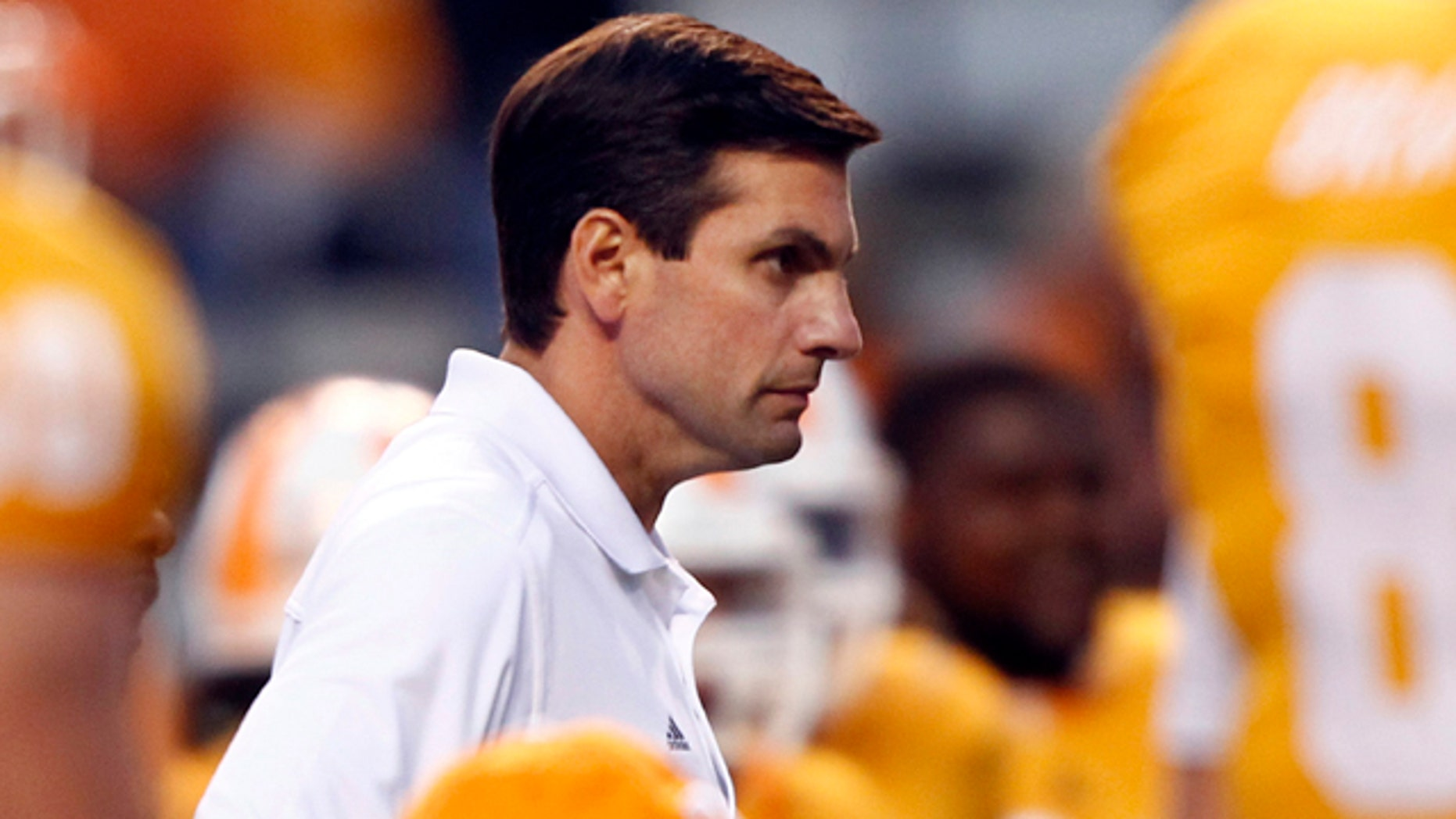 Oct. 23: Tennessee coach Derek Dooley looks on as his team warms up before an NCAA college football game against Alabama at Neyland Stadium in Knoxville, Tenn.