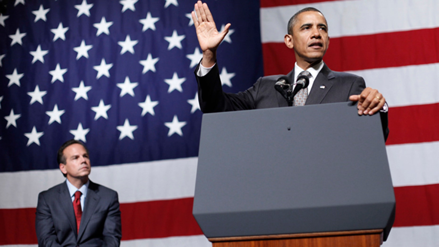 Oct. 25: President Barack Obama delivers remarks at the DCCC reception at the Rhode Island Convention Center in  Providence, R.I. Sitting on stage behind Obama is Providence Mayor and Democratic Congressional candidate David Cicilline.