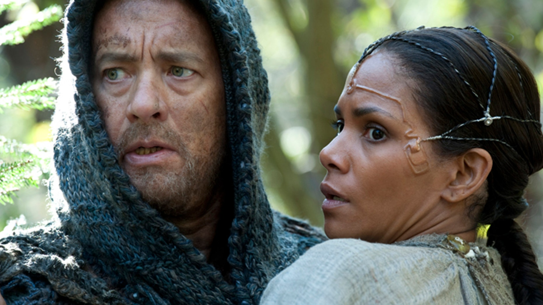 """This film image released by Warner Bros. Pictures shows Tom Hanks as Zachry and Halle Berry as Meronym in a scene from """"Cloud Atlas."""""""