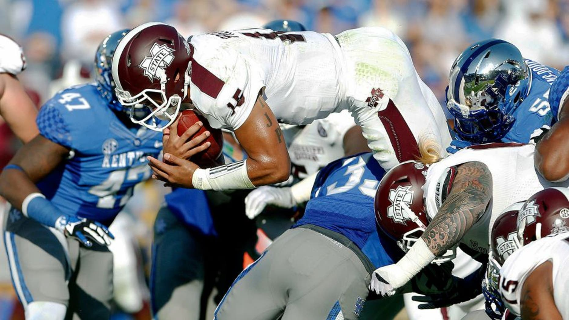 Oct 25, 2014; Lexington, KY, USA; Mississippi State Bulldogs quarterback Dak Prescott (15) dives for a touchdown against the Kentucky Wildcats in the first half at Commonwealth Stadium. Mandatory Credit: Mark Zerof-USA TODAY Sports