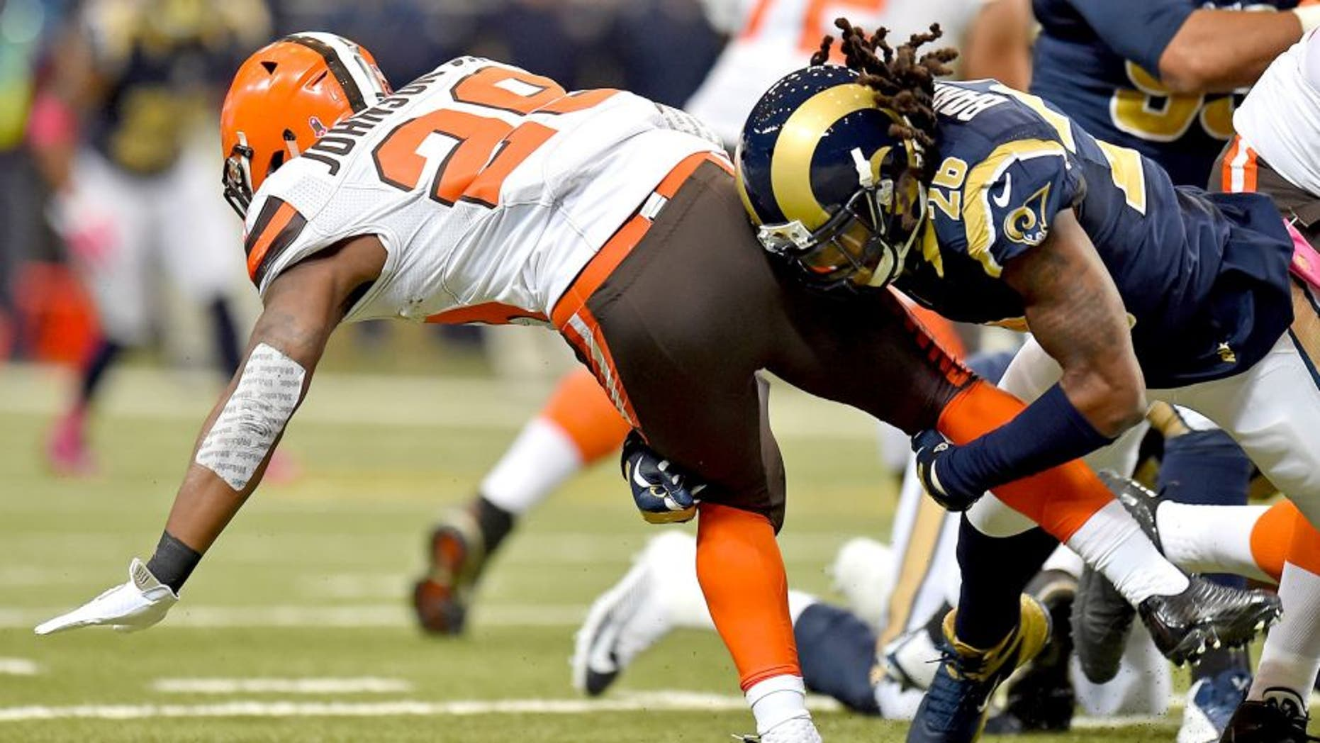 Oct 25, 2015; St. Louis, MO, USA; St. Louis Rams strong safety Mark Barron (26) tackles Cleveland Browns running back Duke Johnson (29) during the first half at the Edward Jones Dome. Mandatory Credit: Jasen Vinlove-USA TODAY Sports